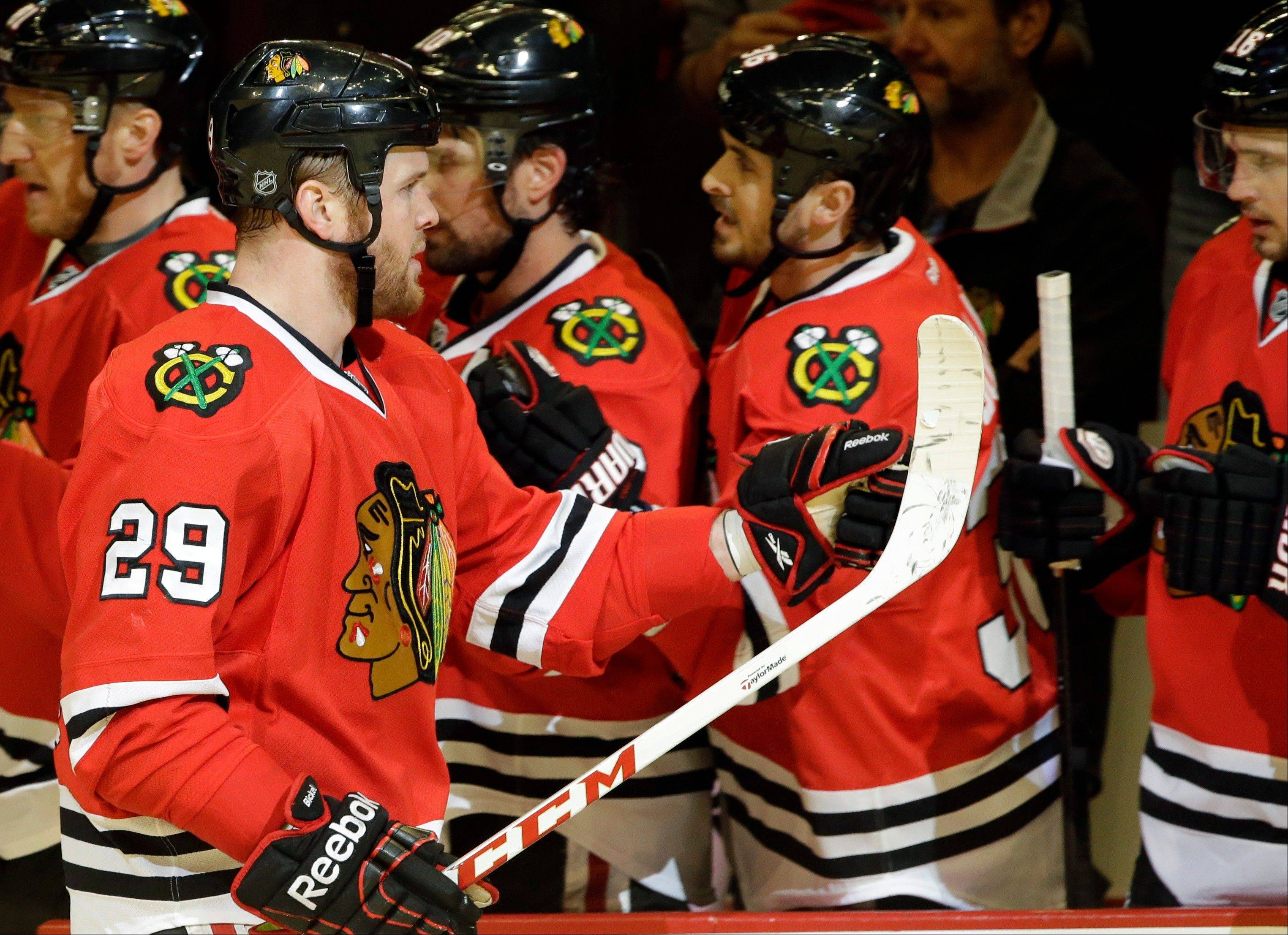 Chicago Blackhawks' Bryan Bickell (29) celebrates with teammates after scoring a goal during the first period of Game 5 of the NHL hockey Stanley Cup playoffs Western Conference semifinals against the Detroit Red Wings in Chicago, Saturday, May 25, 2013.