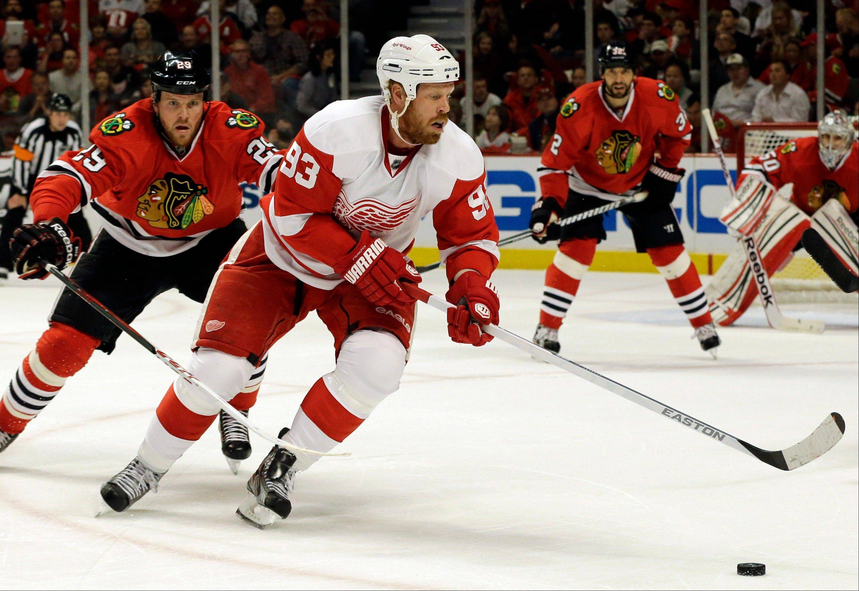 Detroit Red Wings' Johan Franzen (93) controls the puck against Chicago Blackhawks' Bryan Bickell (29) during the first period of Game 5 of the NHL hockey Stanley Cup playoffs Western Conference semifinals in Chicago, Saturday, May 25, 2013.