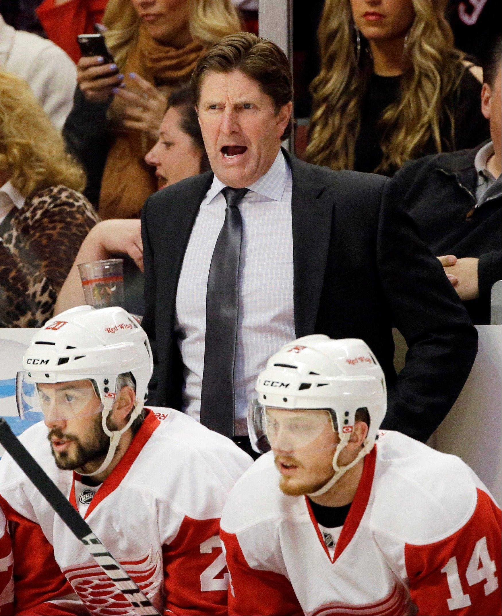 Detroit Red Wings head coach Mike Babcock, top, yells to his team during the first period of Game 5 of the NHL hockey Stanley Cup playoffs Western Conference semifinals against the Chicago Blackhawks in Chicago, Saturday, May 25, 2013.