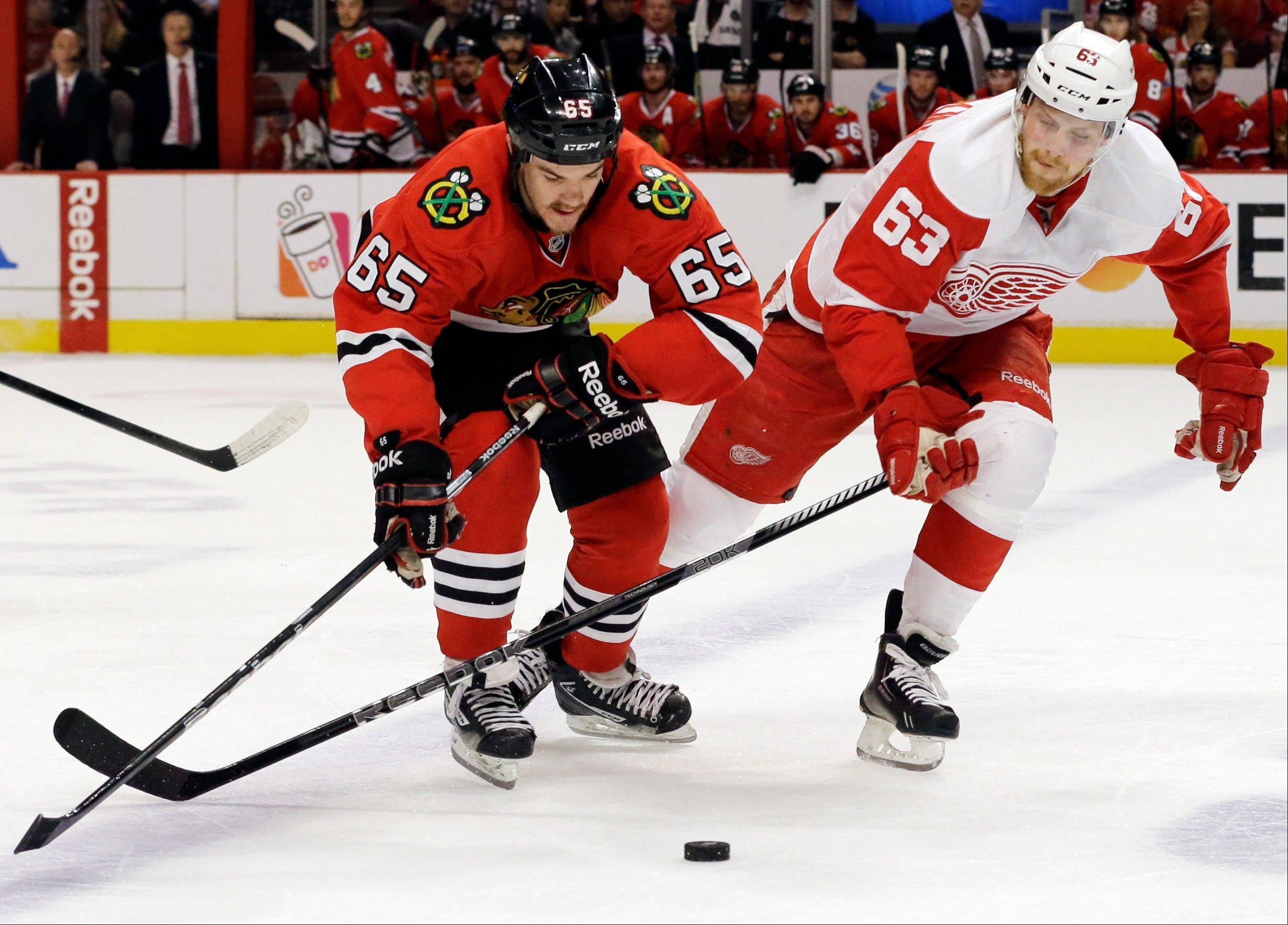 Chicago Blackhawks' Andrew Shaw, left, battles for the puck against Detroit Red Wings' Joakim Andersson (63) during the second period of Game 5 of the NHL hockey Stanley Cup playoffs Western Conference semifinals in Chicago, Saturday, May 25, 2013. The Blackhawks won 4-1.