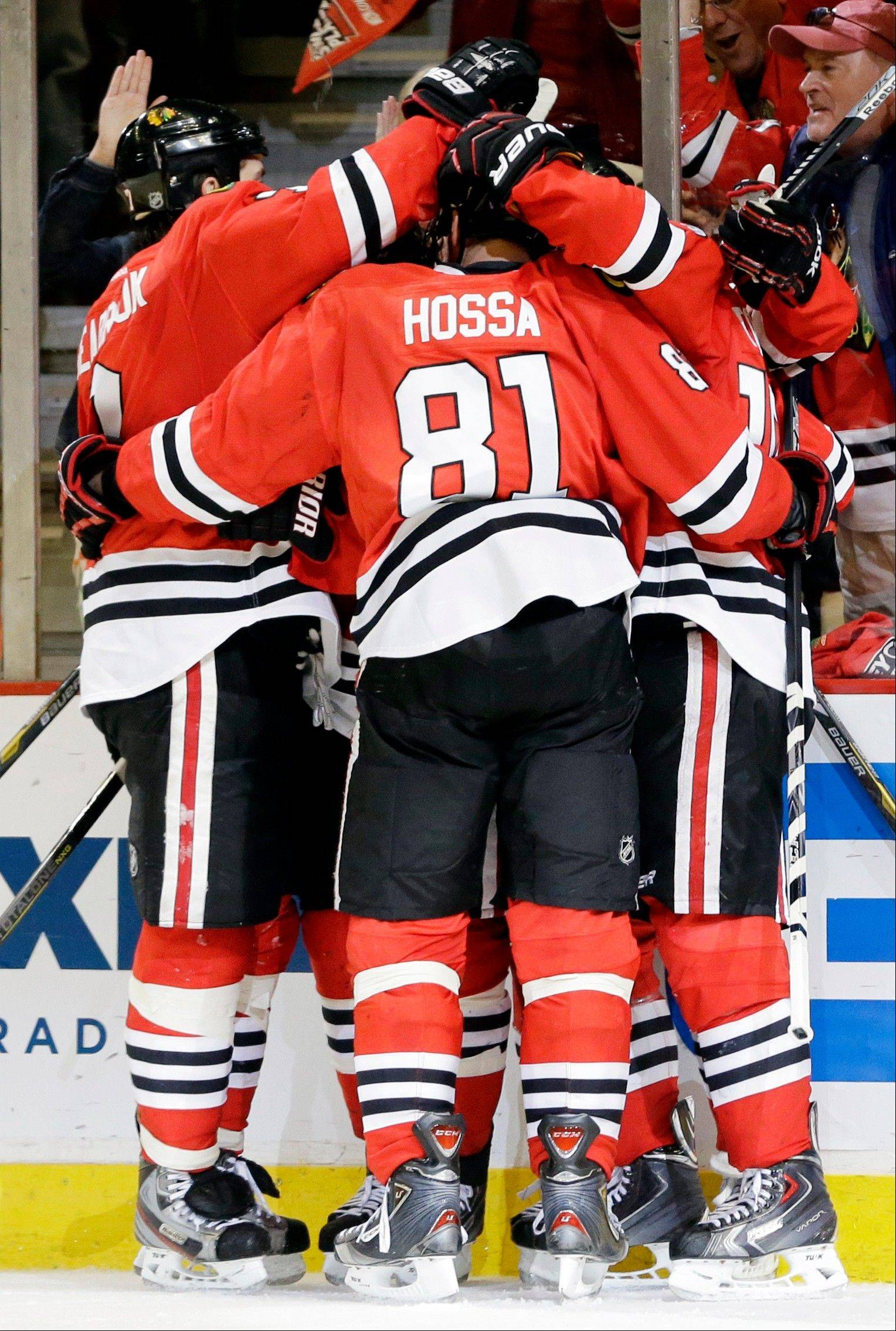 Chicago Blackhawks' Andrew Shaw celebrates with teammates after scoring a goal during the second period of Game 5 of the NHL hockey Stanley Cup playoffs Western Conference semifinals against the Detroit Red Wings in Chicago, Saturday, May 25, 2013.