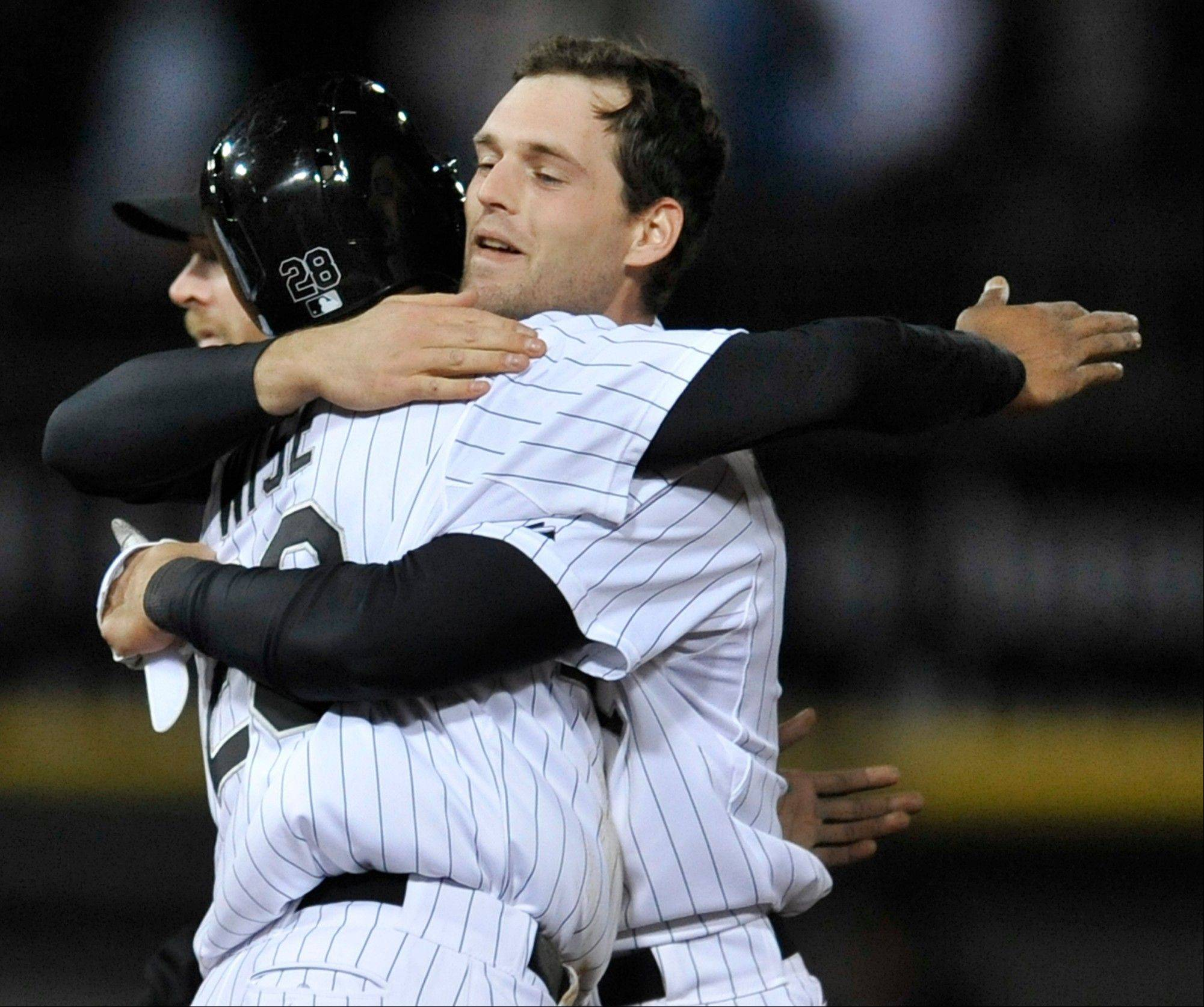 Chicago White Sox's Conor Gillaspie, right, celebrates with teammate Dewayne Wise, left, after Wise scored the game-winning run on a single hit by Gillaspie during the ninth inning of a baseball game against the Miami Marlins in Chicago, Saturday, May 25, 2013. Chicago won 2-1.