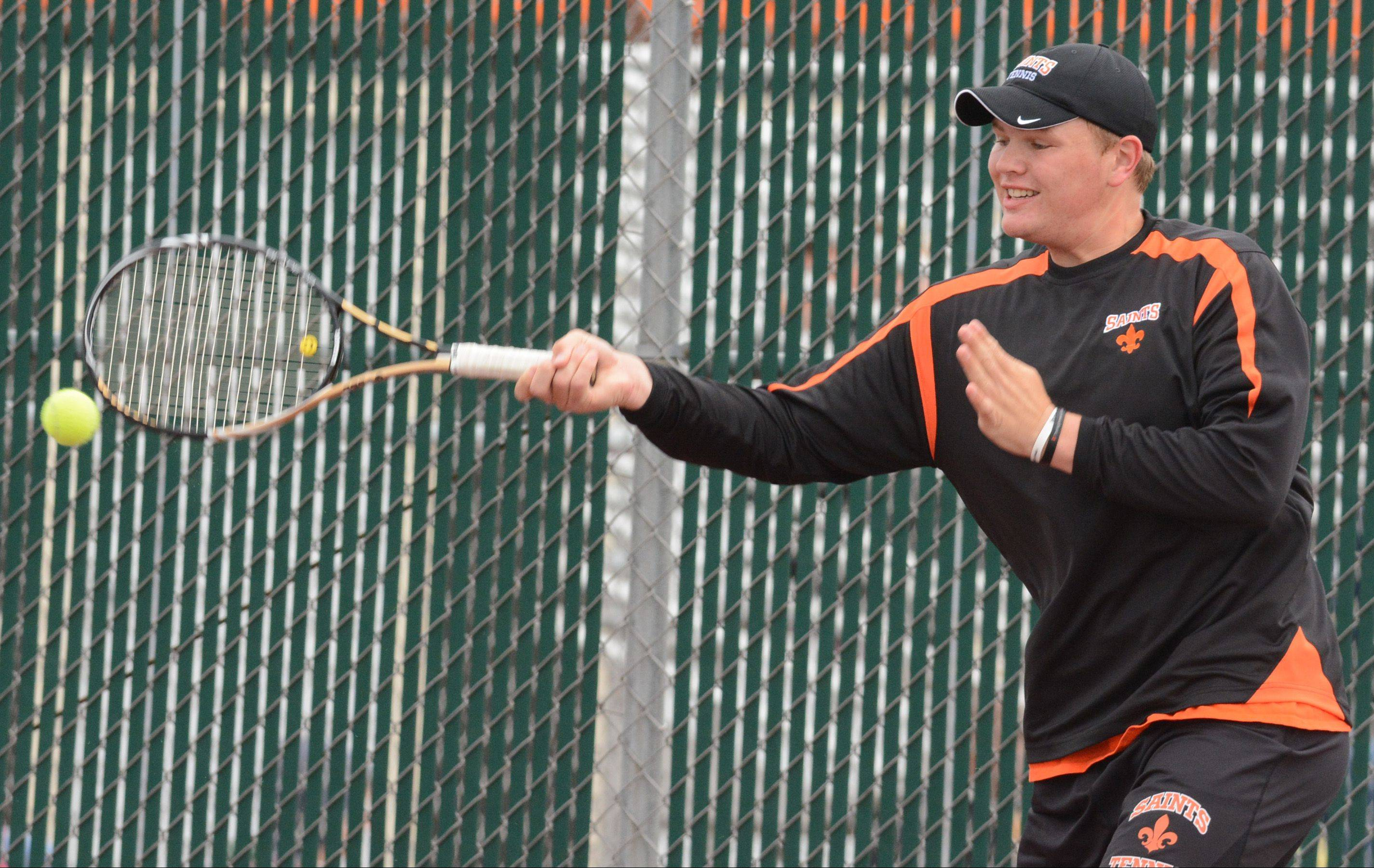 Jasper Koenen of St. Charles East competes at the state boys tennis tournament Saturday
