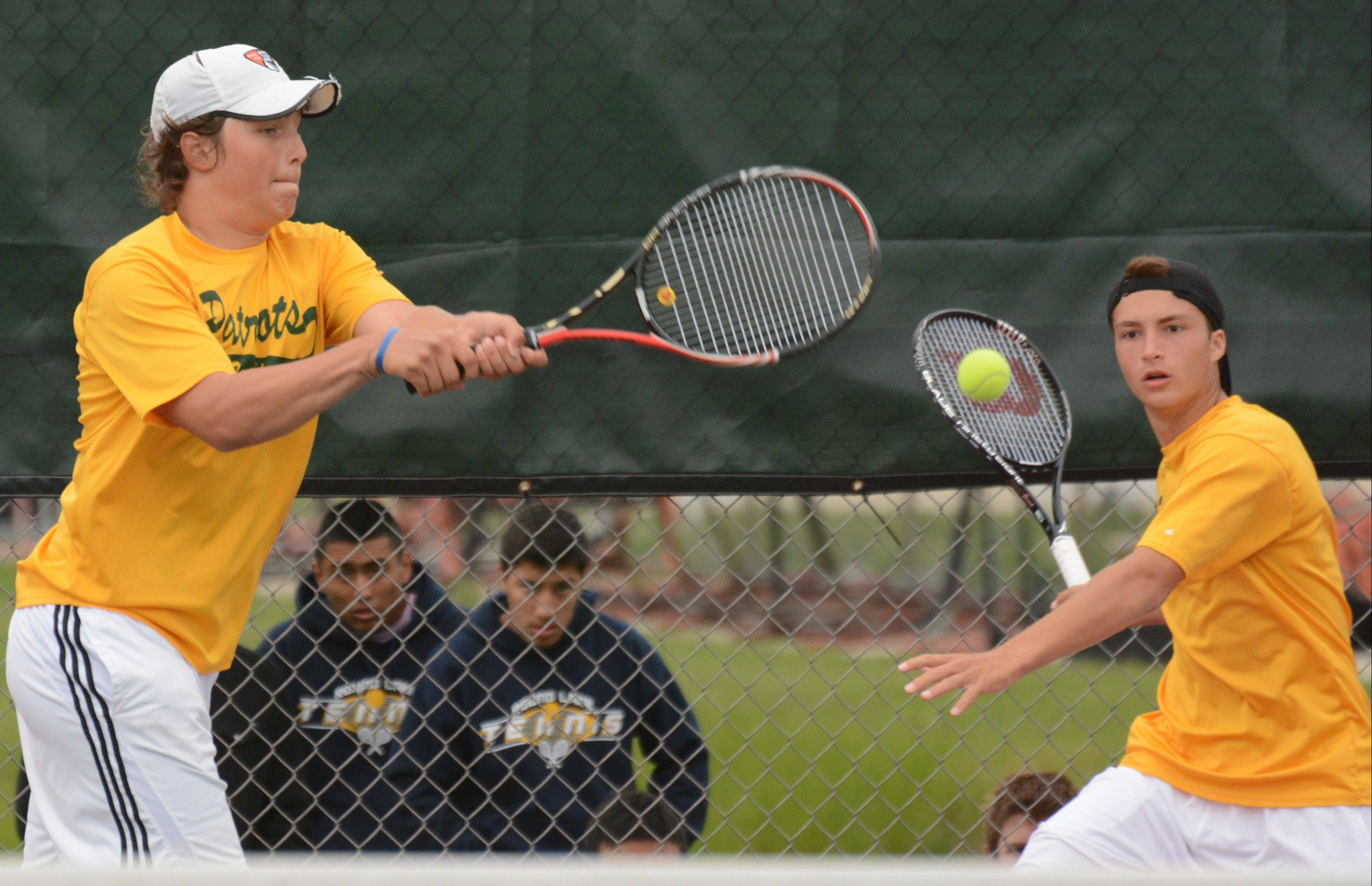 From left, Andrew Komarov and Colin Harvey of Stevenson compete in doubles at the boys tennis state tournament on Saturday at Hersey.