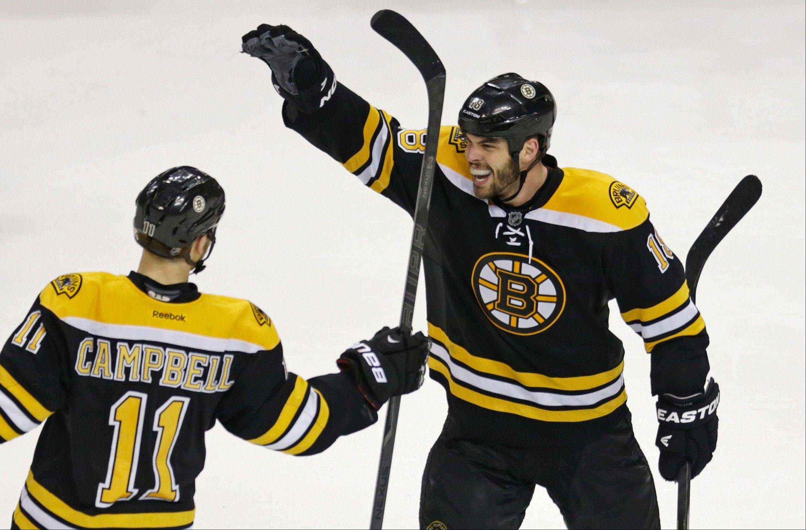 Boston Bruins center Gregory Campbell (11) is congratulated by teammate Nathan Horton, right, after his goal against the New York Rangers during the third period in Game 5 of the Eastern Conference semifinals in the NHL hockey Stanley Cup playoffs in Boston, Saturday, May 25, 2013. The Bruins won 3-1 and advance in the playoffs.