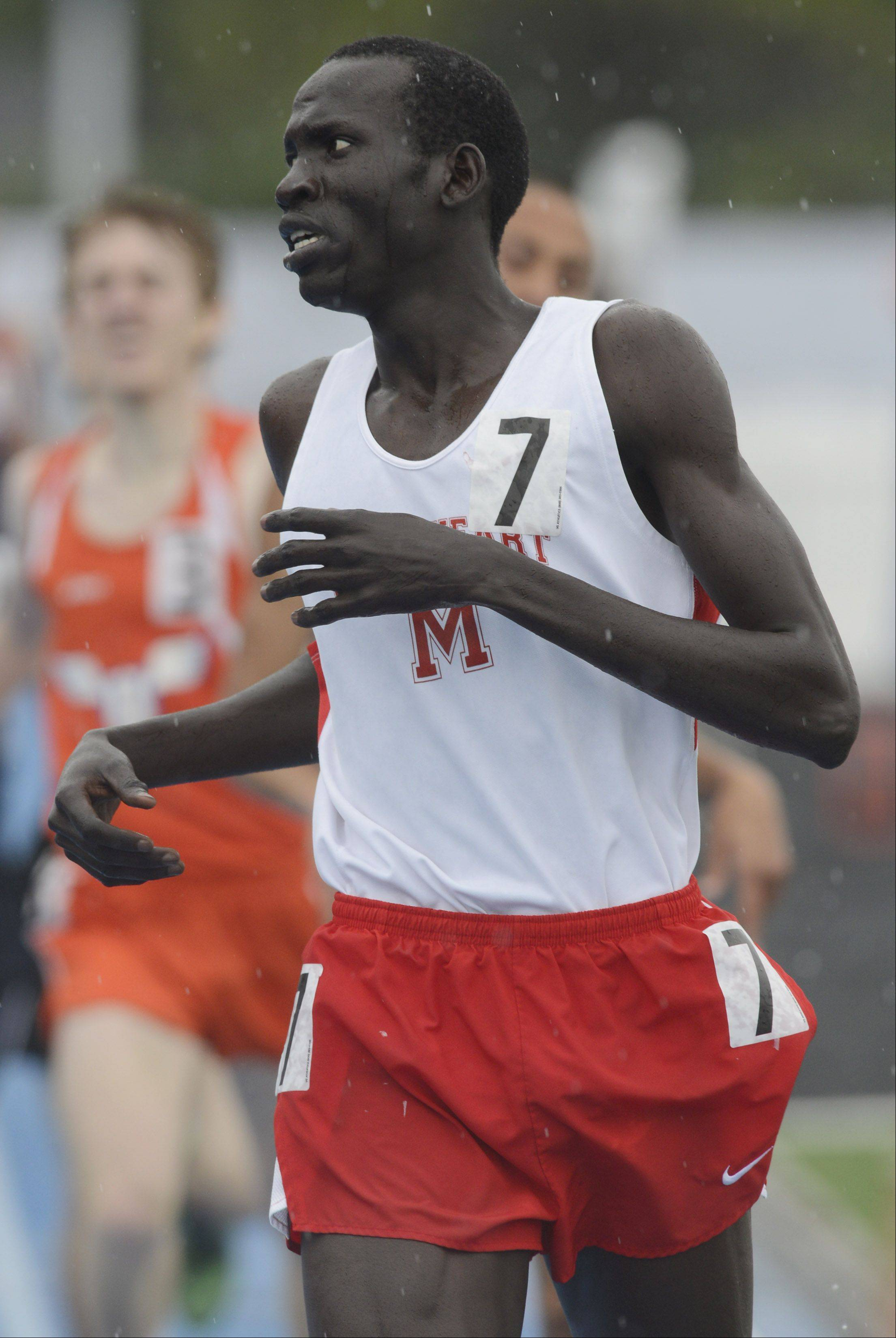 Mooseheart's Wal Khat crosses the finish line in the Class 1A 800-meter run during the boys state track finals in Charleston Saturday.