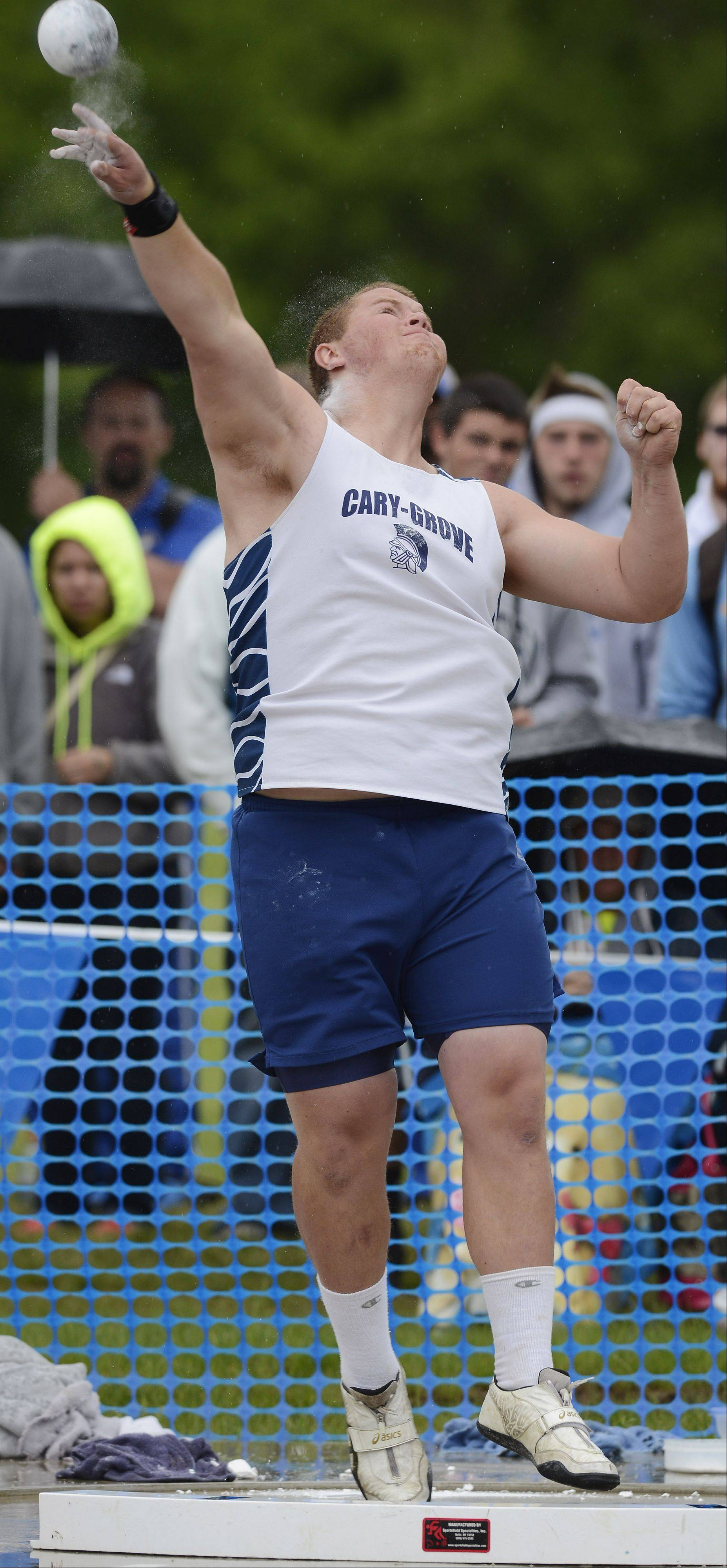 Cary-Grove's Ricky Hurley throws in the Class 3A shot put during the boys state track finals in Charleston Saturday.