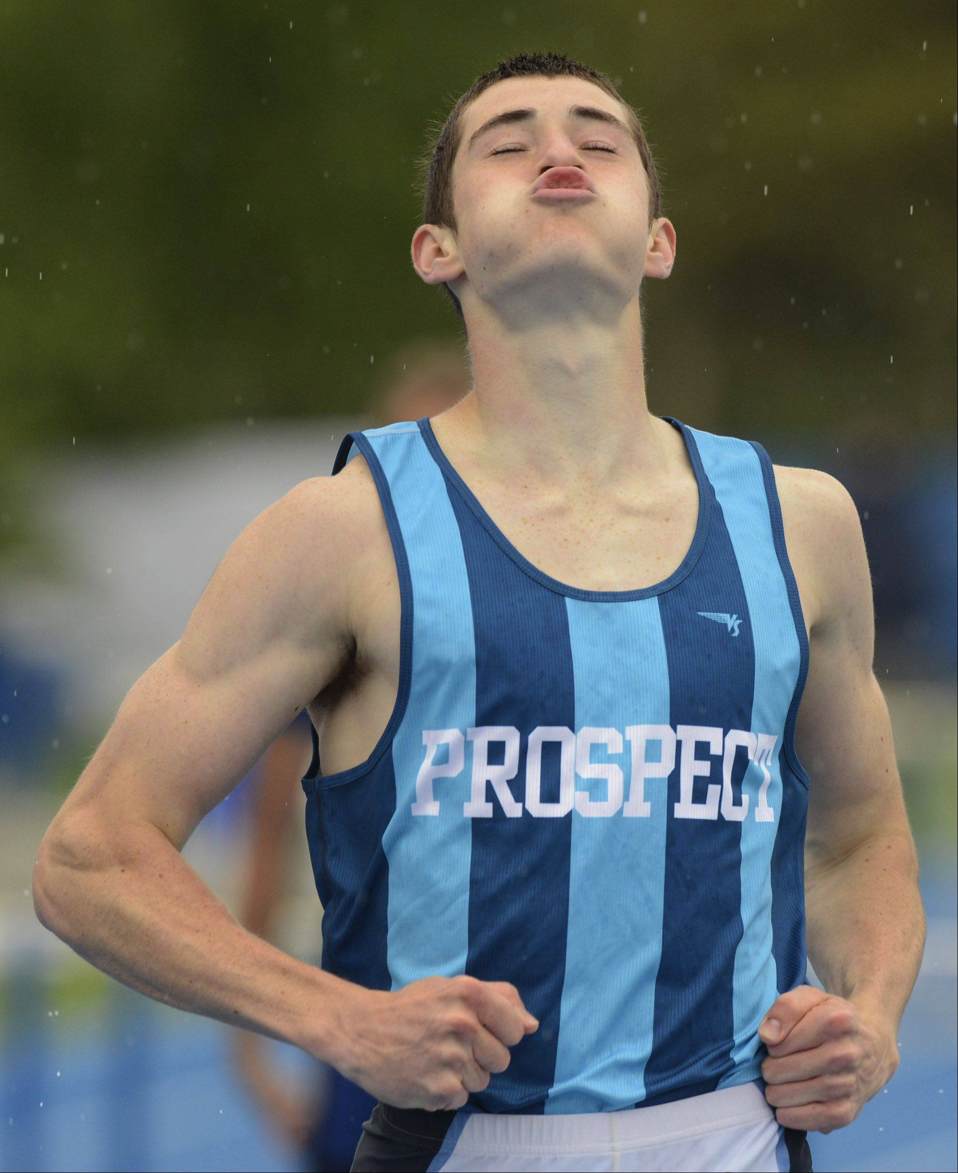 Prospect's Dave Kendziera puckers his lips at the finish line as he wins the Class 3A 300-meter intermediate hurdles during the boys state track finals in Charleston Saturday.