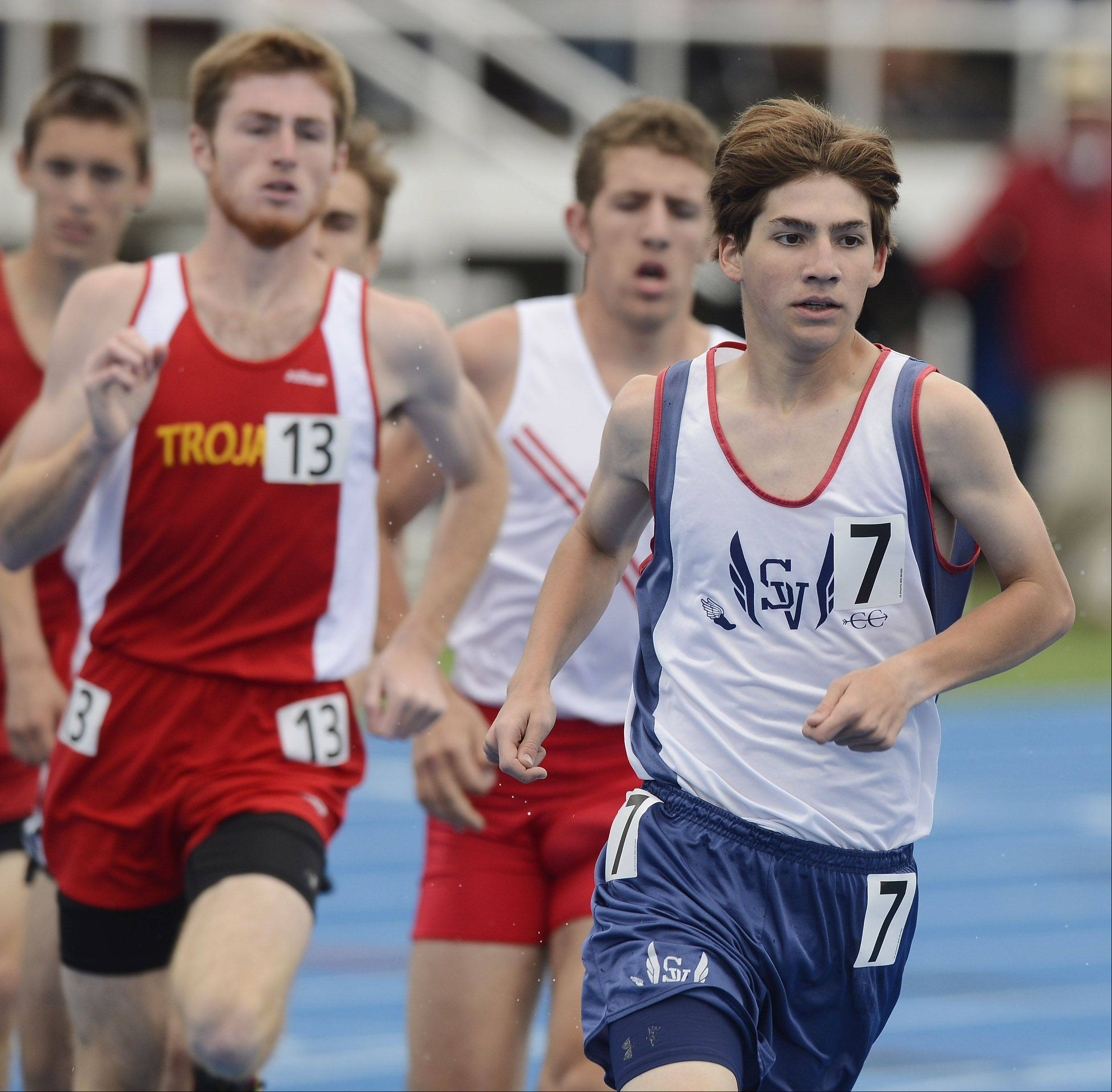 St. Viator's Nick Brey, right, competes in the Class 2A 3,200-meter run during the boys state track finals in Charleston Saturday.