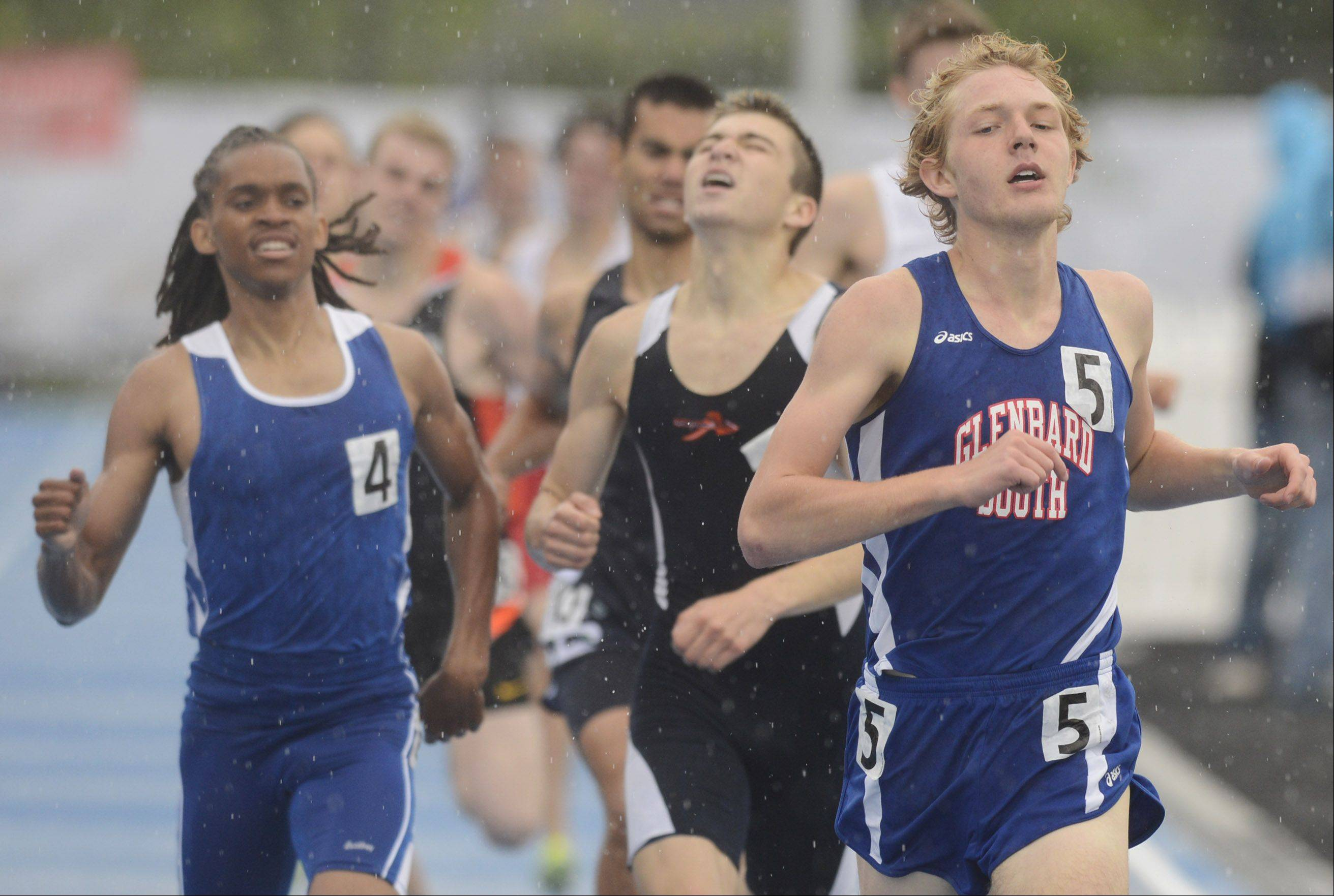 Glenbard South's John Wold, right, heads for the finish line in the Class 2A 800-meter run during the boys state track finals in Charleston Saturday.