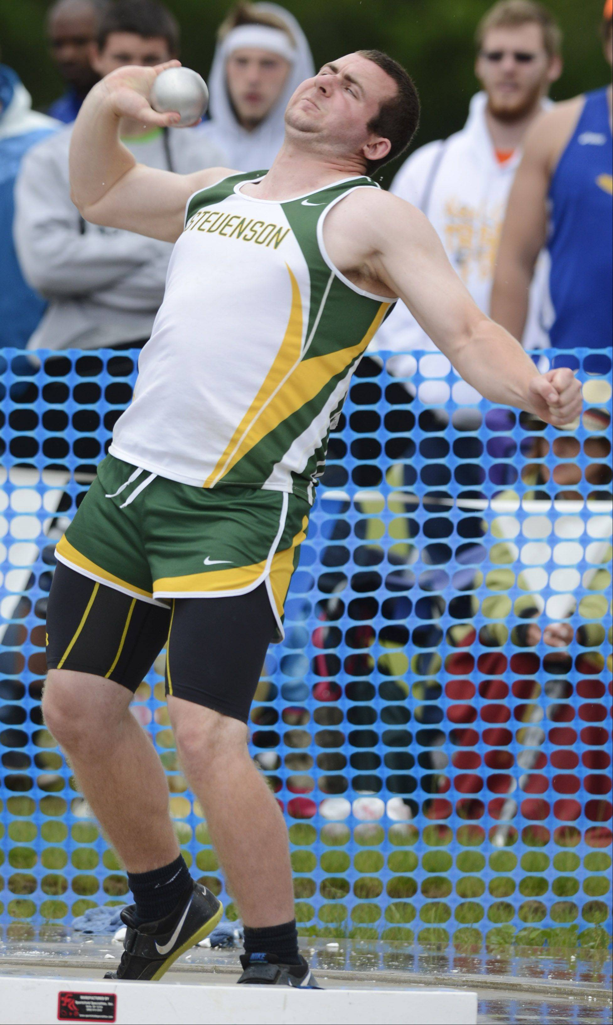 Stevenson's Jordan Fobbe throws in the Class 3A shot put during the boys state track finals in Charleston Saturday.
