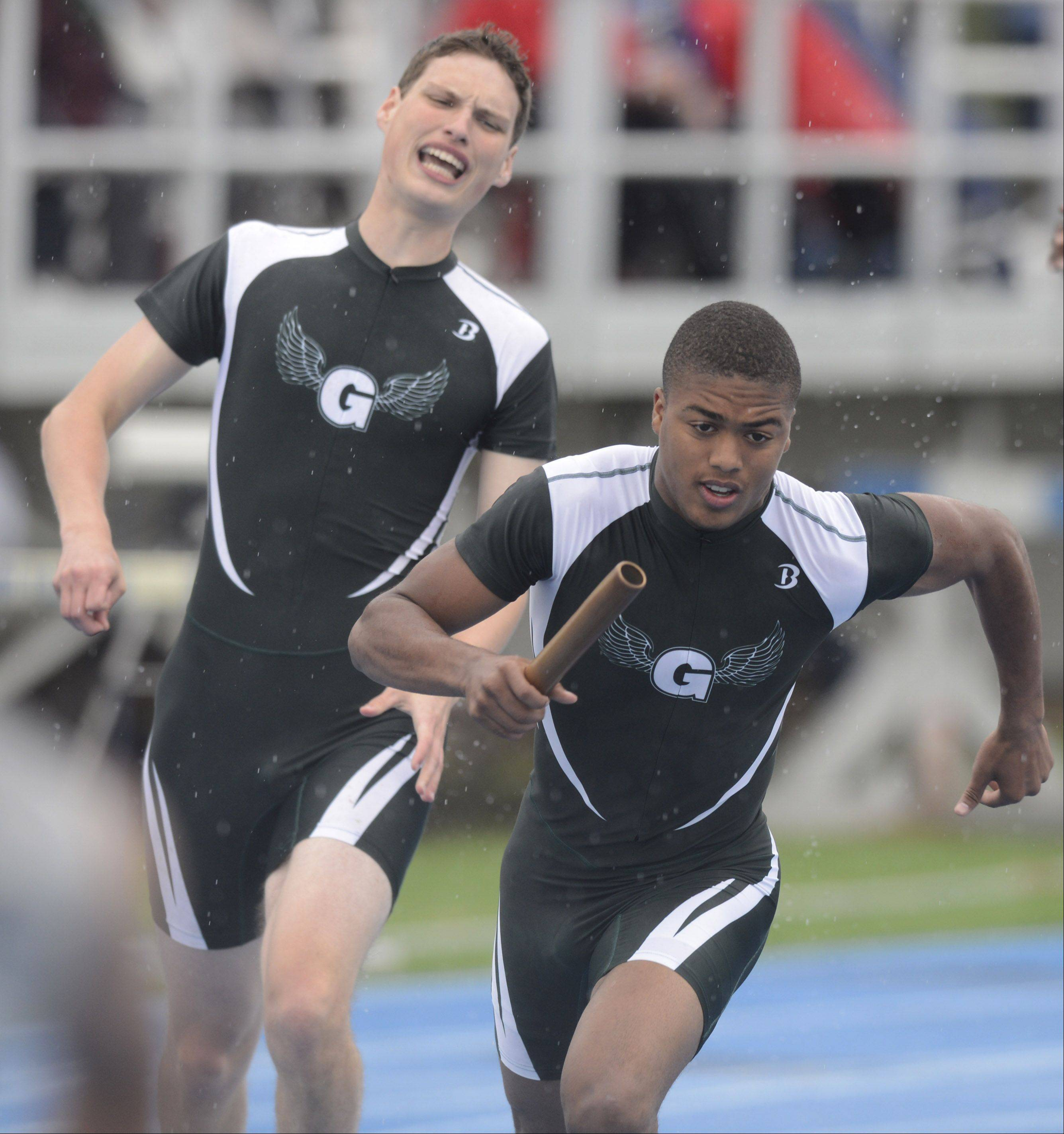 Grayslake Central's Kacey Adams takes the baton from teammate Matt Weatherhead in the Class 2A 4x200-meter relay during the boys state track finals in Charleston Saturday.