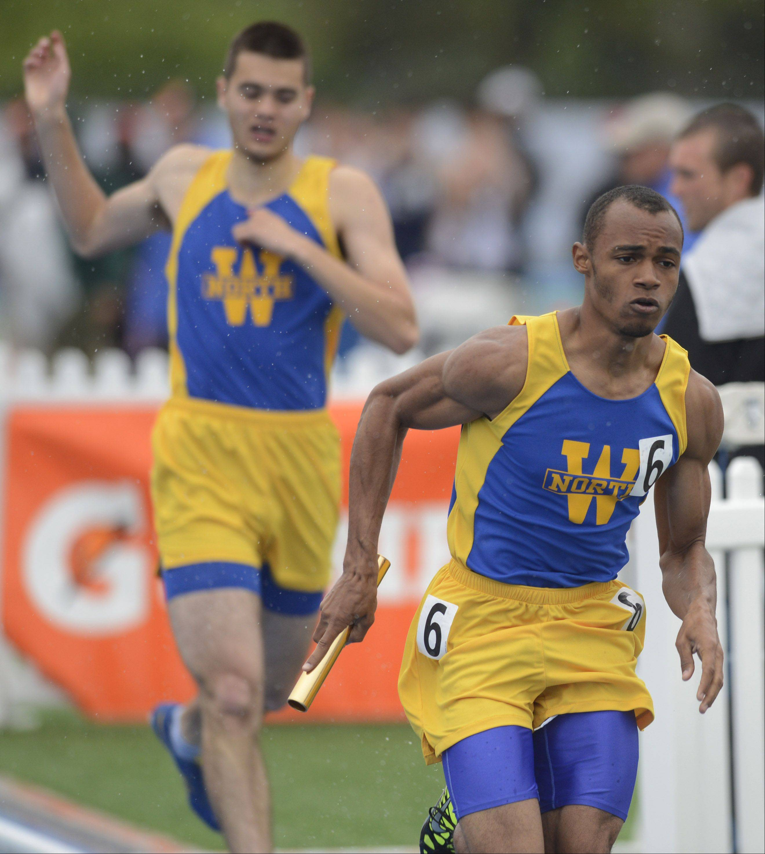 Wheaton North's Micaiah Steele carries the baton for his team in the Class 3A 4x400-meter relay during the boys state track finals in Charleston Saturday.