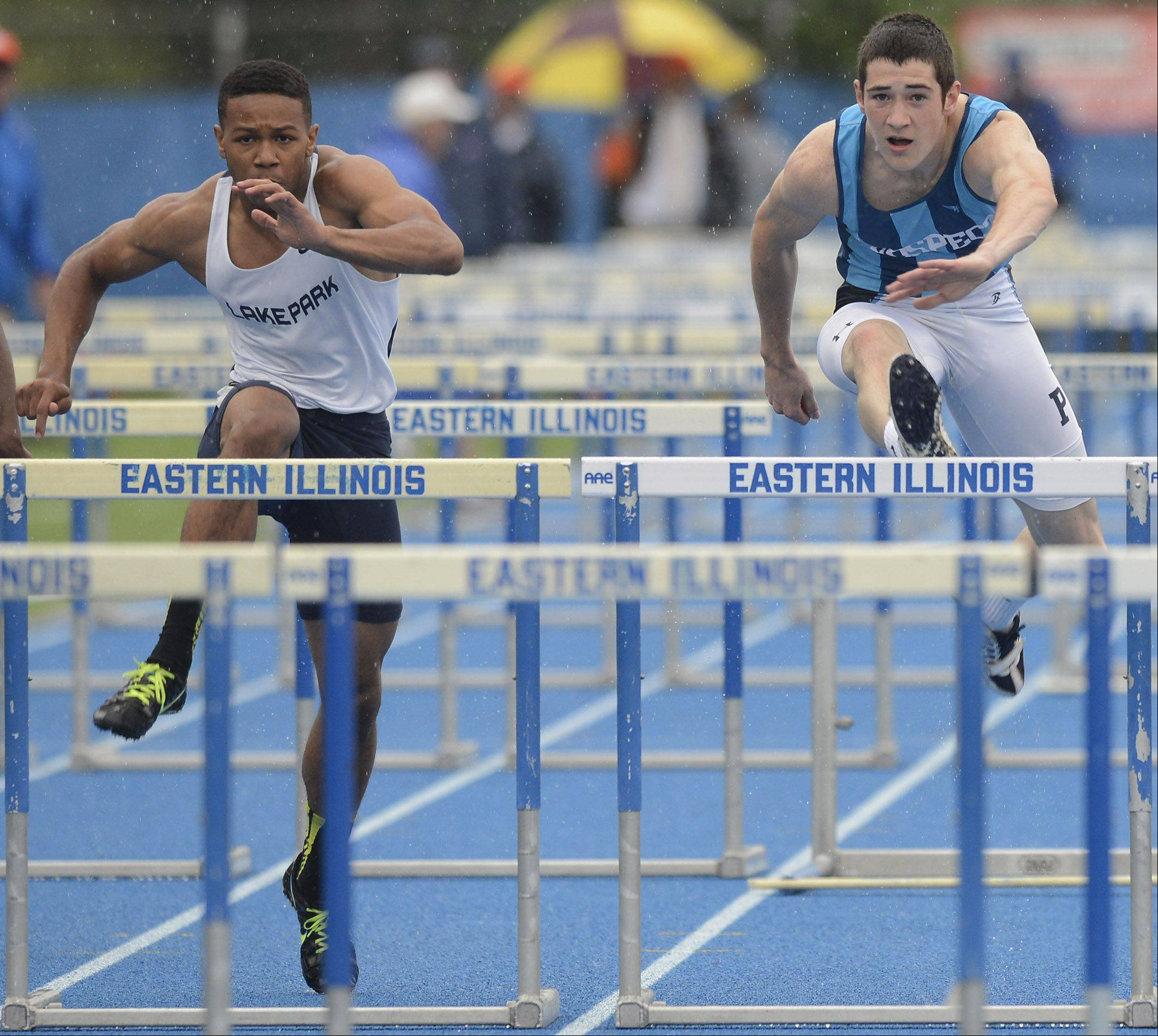 Lake Park's Antonio Shenault, left, and Prospect's Dave Kendziera compete in the Class 3A 110-meter high hurdles during the boys state track finals in Charleston Saturday.