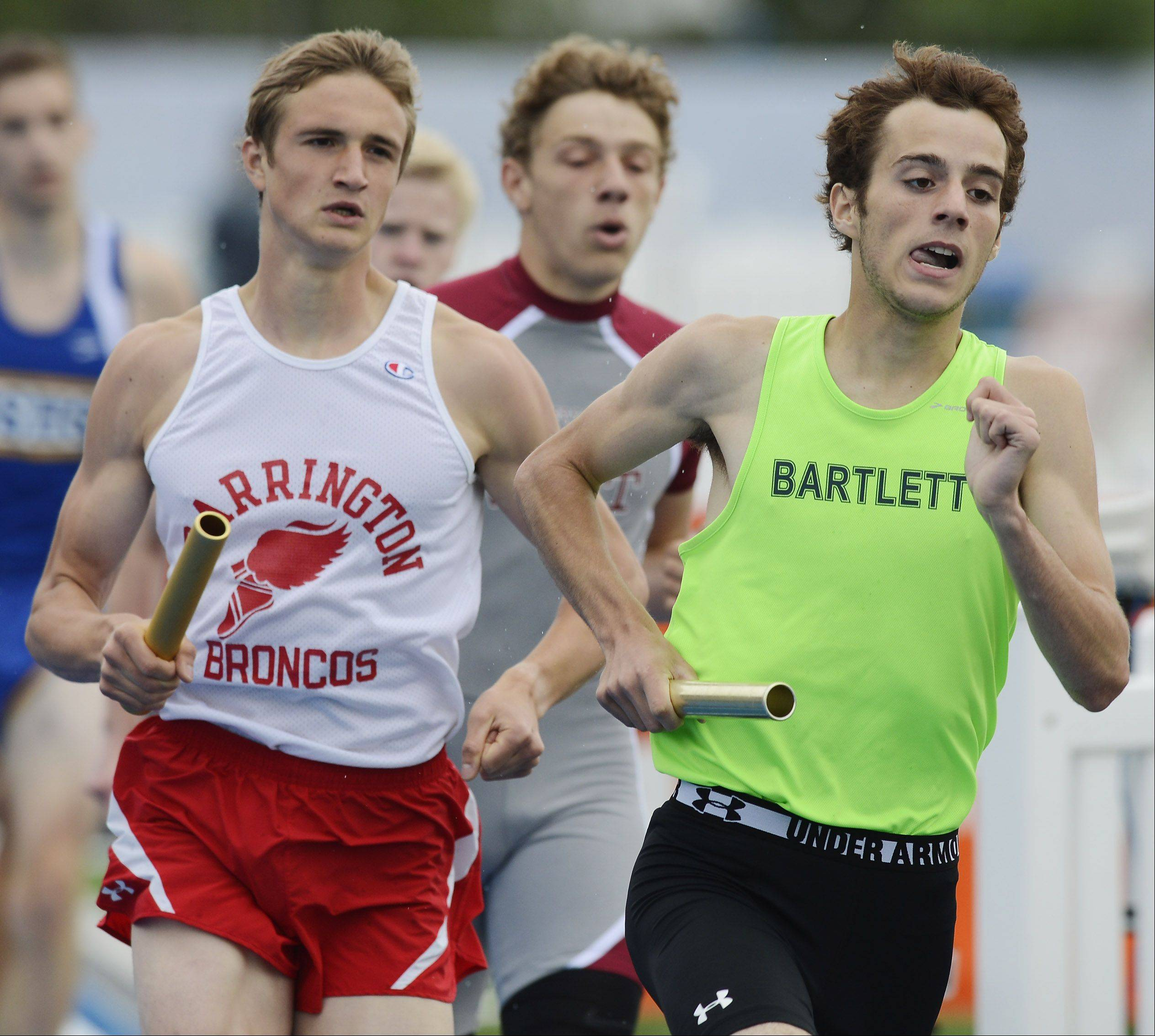 Barrington's David Cerny, left, is right behind Bartlett's Matt Hess in the Class 3A 4x800-meter relay during the boys state track finals in Charleston Saturday. Barrington won the event.