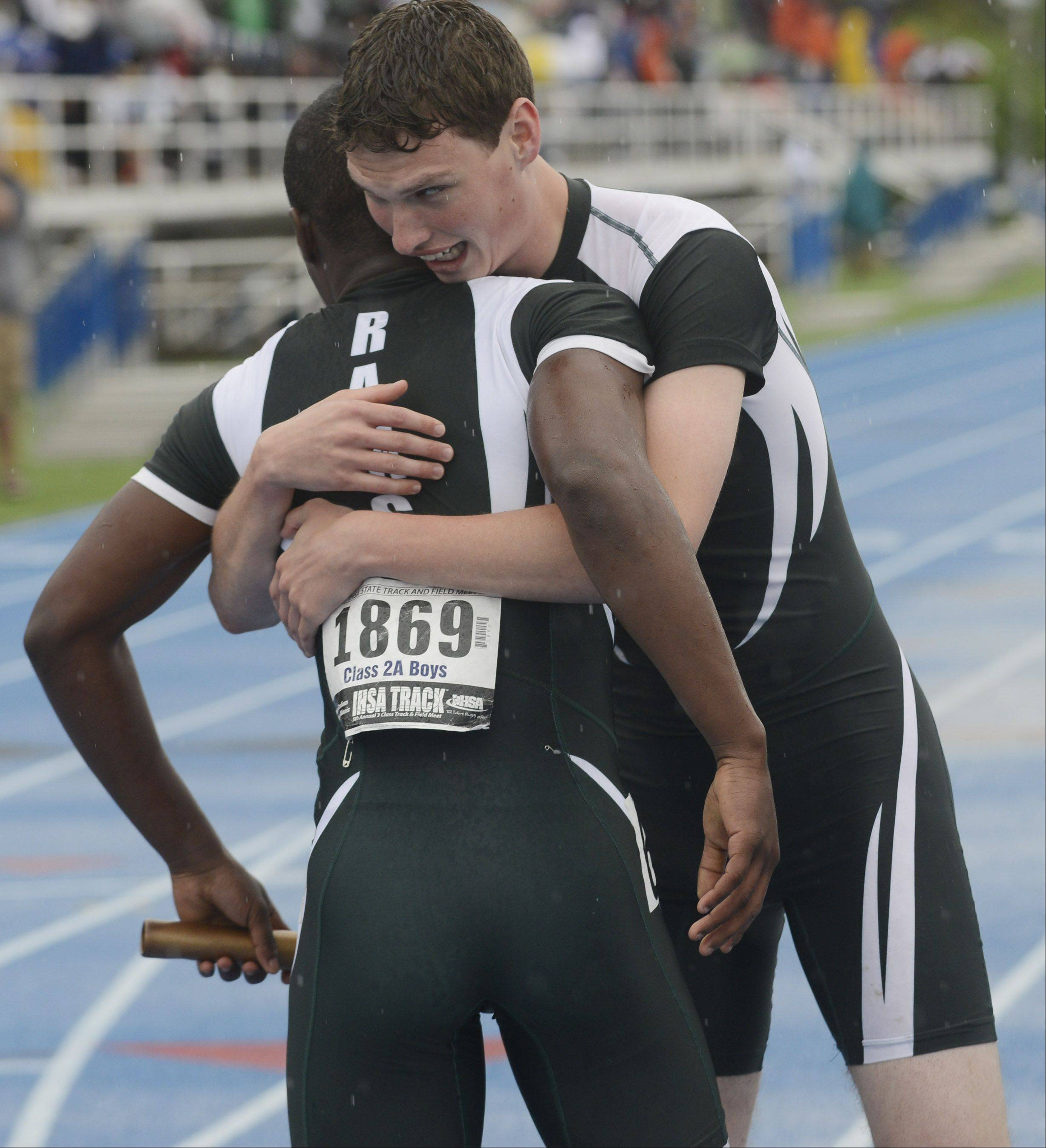 Grayslake Central's Matt Weatherhead, right, hugs teammate Dimitri Dawson at the finish line after the Rams won the class 2A 4x200-meter relay during the boys state track finals in Charleston Saturday.