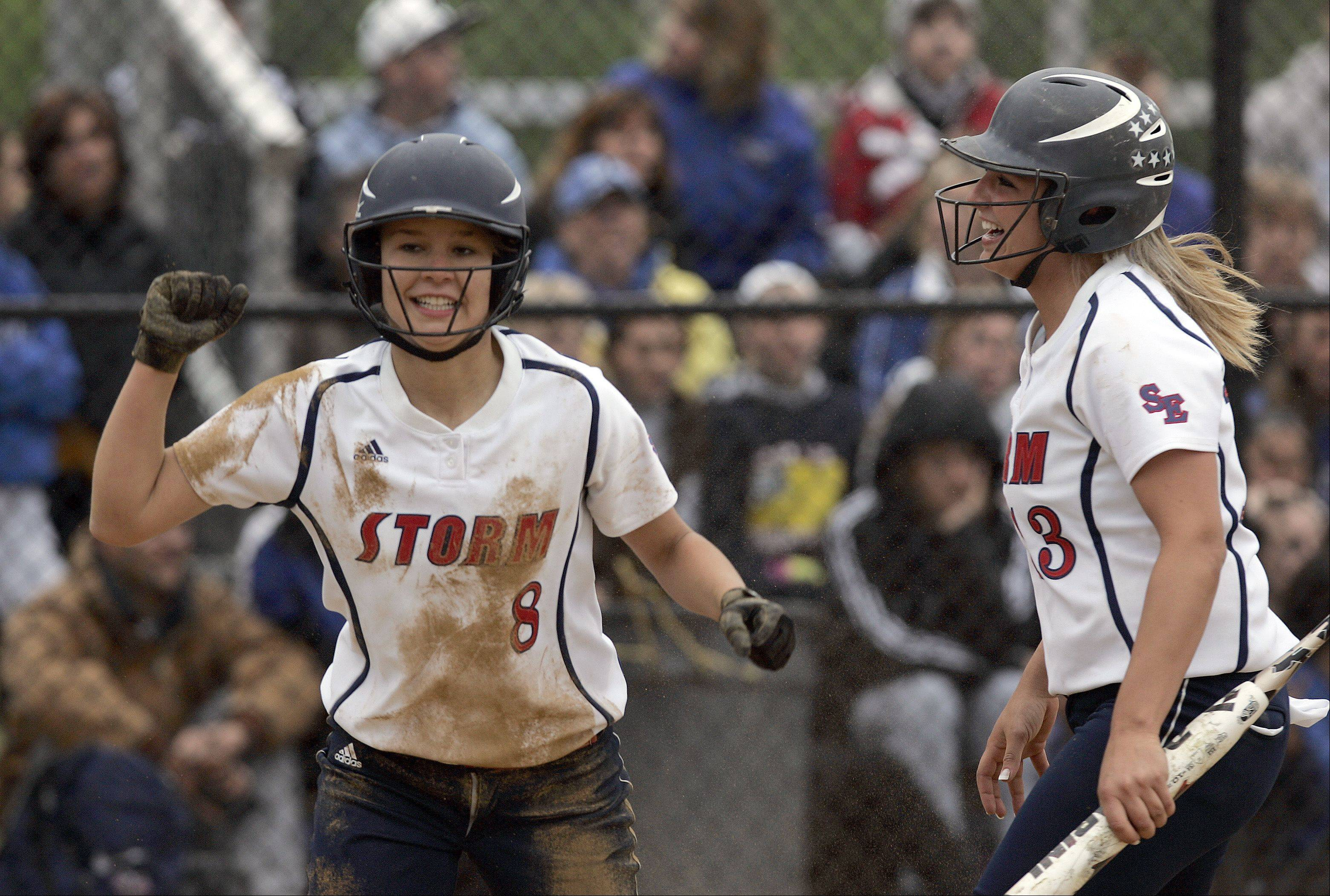 South Elgin's Victoria Watt (8) is greeted at the plate by Alyssa Buddle after scoring what turned out to be the game-winning run in a 2-1 win over St. Charles North in the Class 4A regional softball final at St. Charles North Saturday.