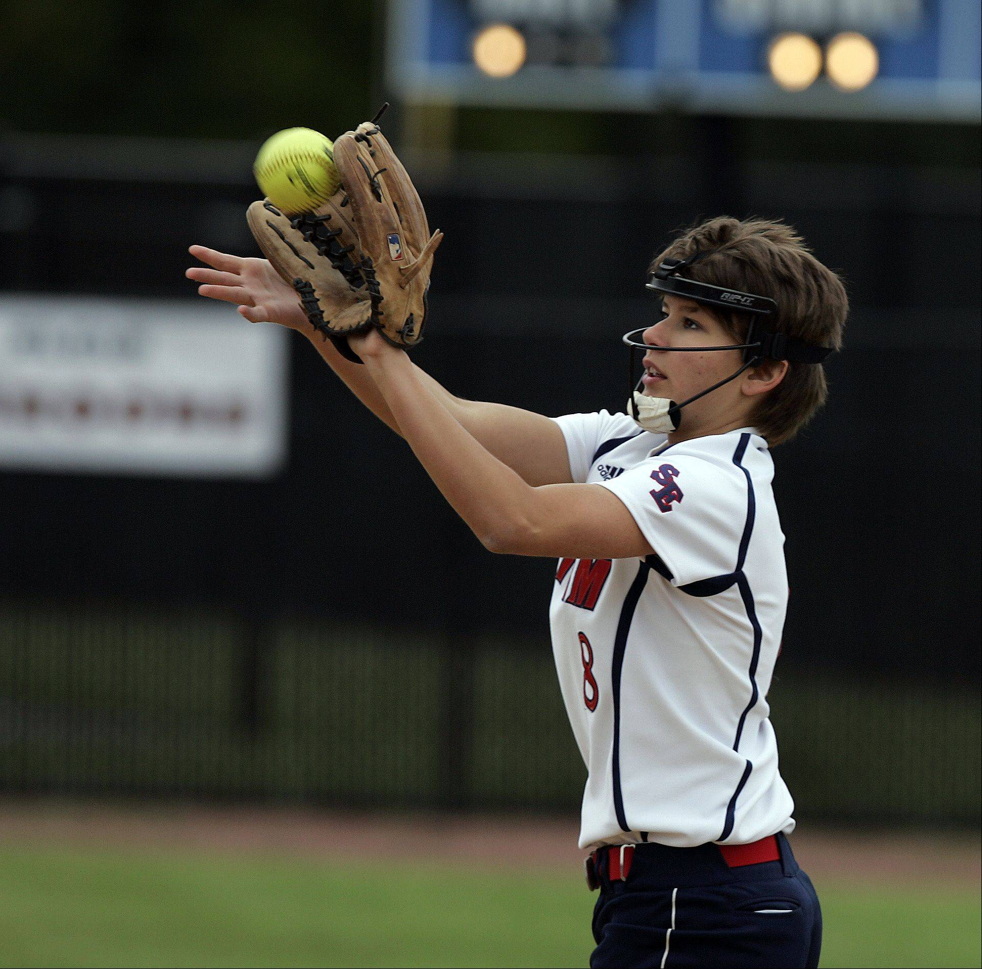 South Elgin's Victoria Watt (8) reels in a shot during the Class 4A regional softball final at St. Charles North Saturday.
