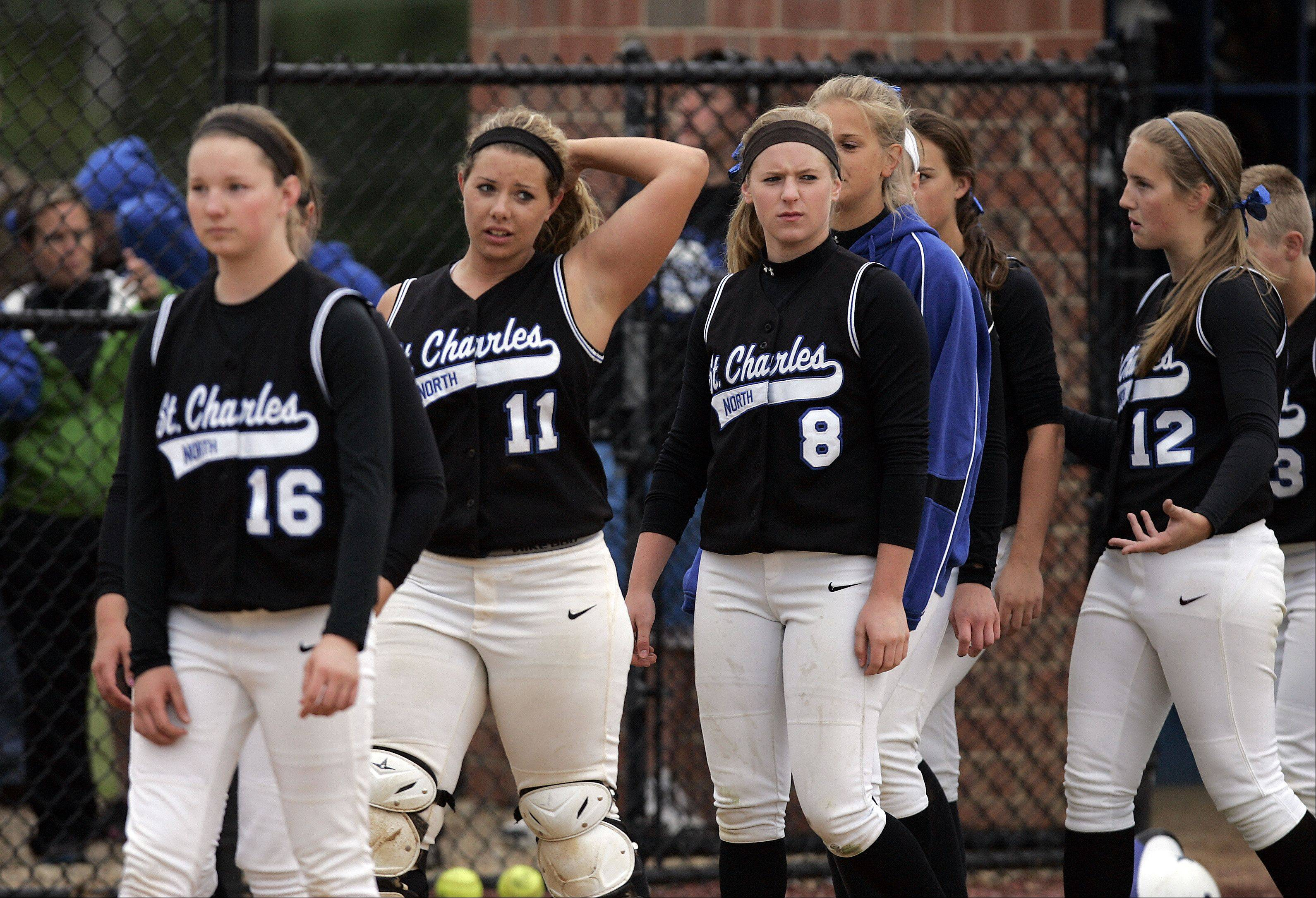 St. Charles North reacts after losing to South Elgin Saturdy in the Class 4A regional softball finals.