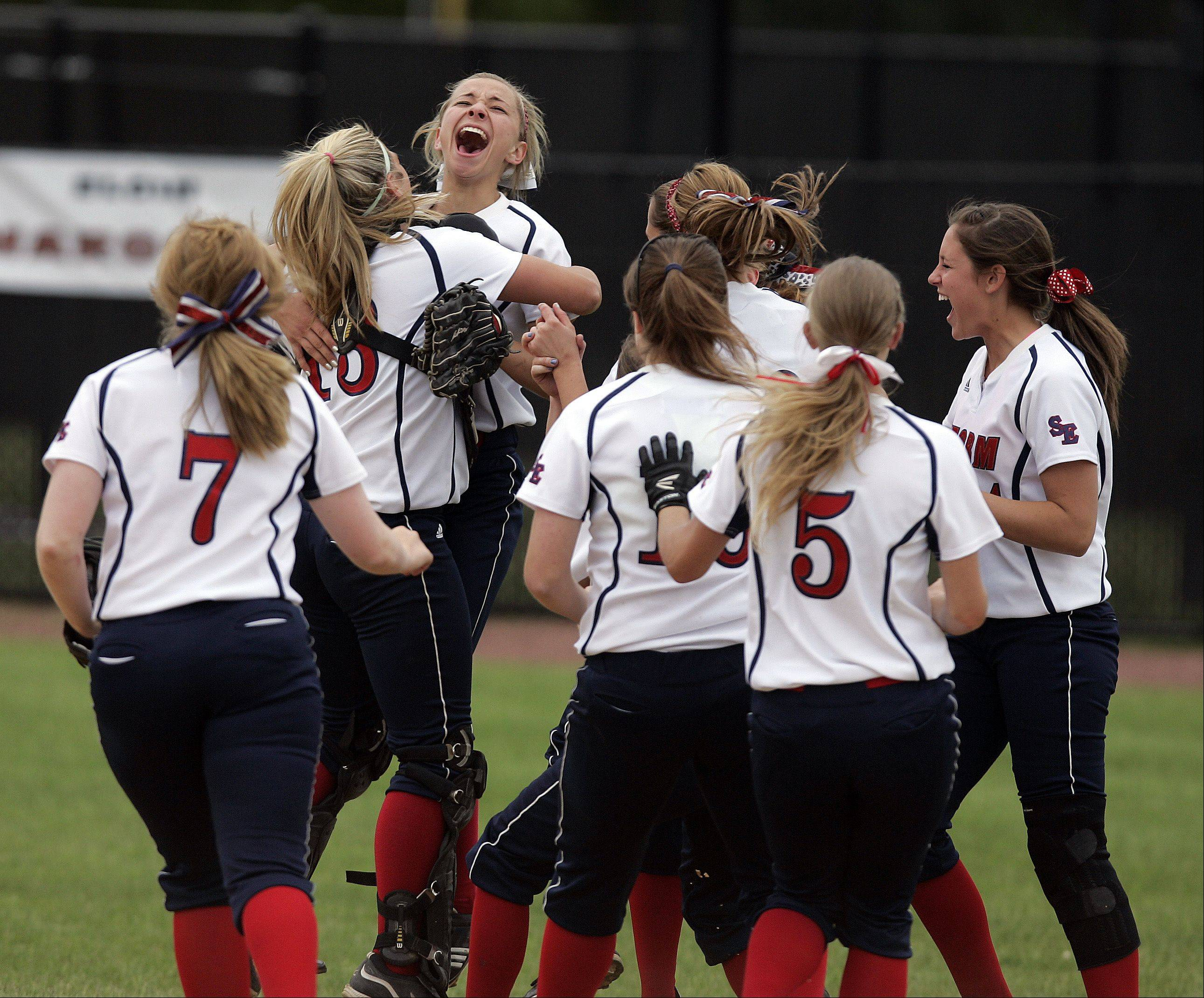 South Elgin's Mallory Mecklenburg (2) is greeted by her teammates after South Elgin won the Class 4A softball regional Saturday.