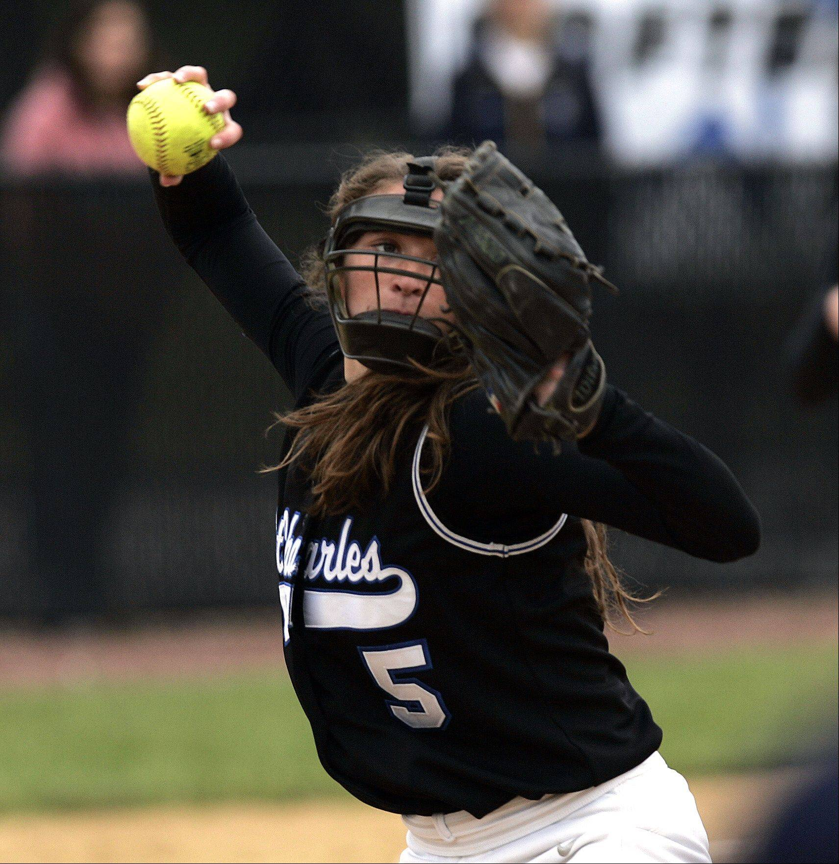 St. Charles North's Sabrina Rabin throws to first during the Class 4A regional softball final at St. Charles North Saturday.