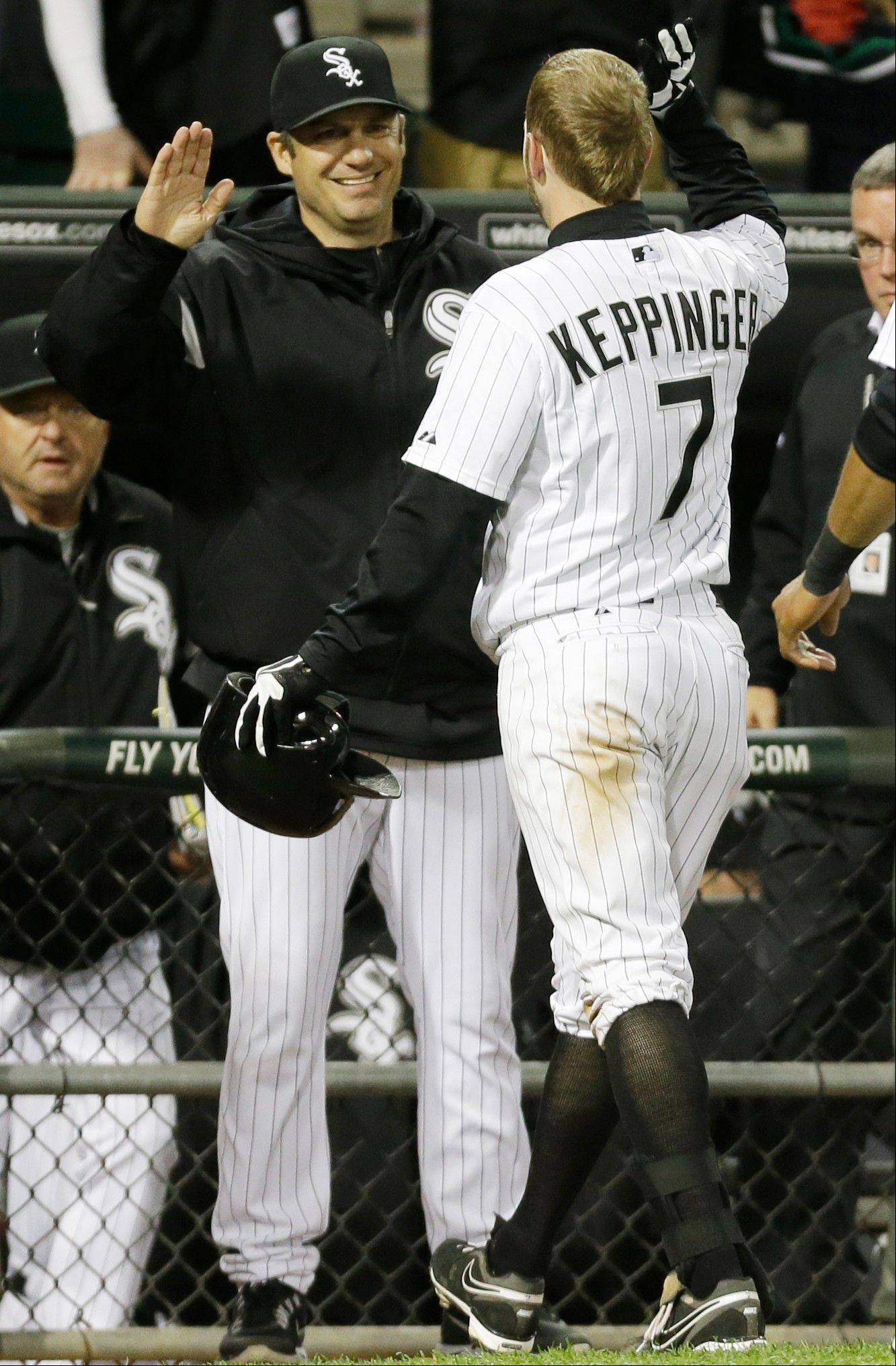 Chicago White Sox's Jeff Keppinger (7) celebrates with manager Robin Ventura after hitting a game-winning single against the Miami Marlins during the 11th inning of a baseball game on Friday, May 24, 2013, in Chicago. The White Sox won 4-3.