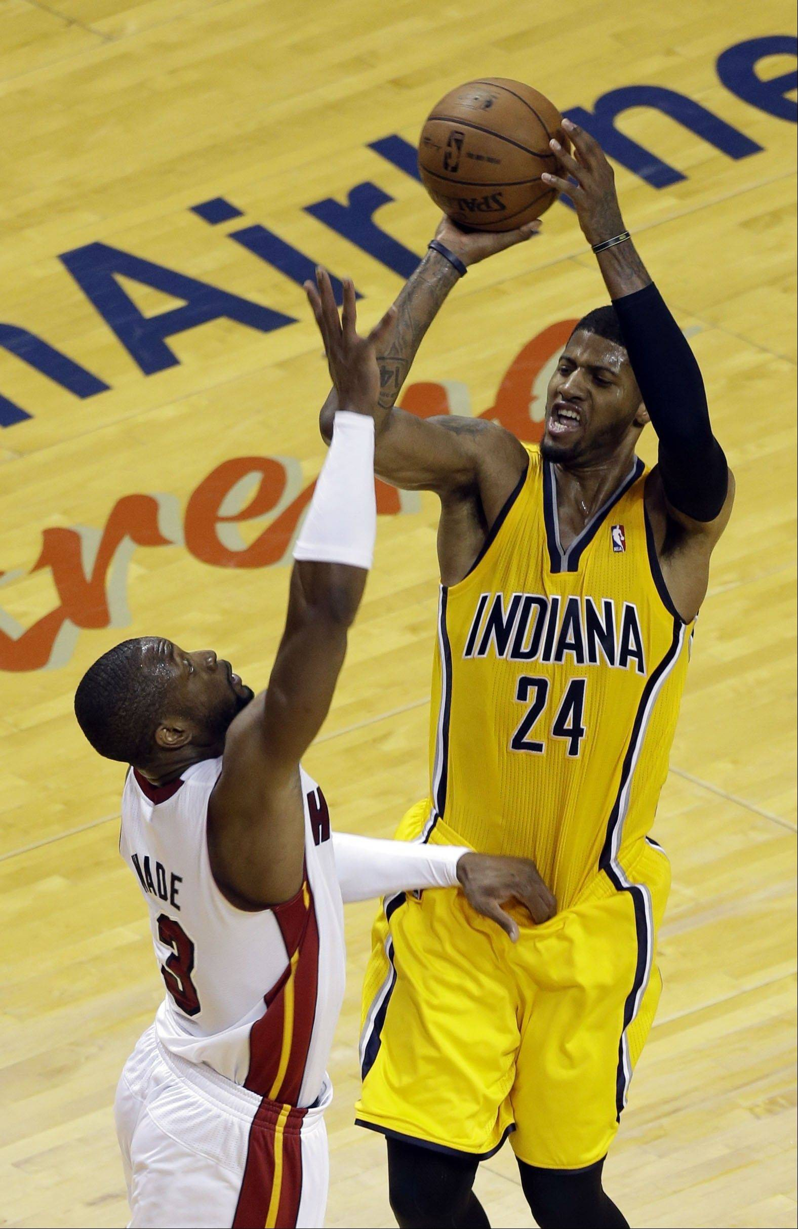 Indiana Pacers forward Paul George (24) attempt to score as Miami Heat guard Dwyane Wade (3) defends during the second half of Game 2 in their NBA basketball Eastern Conference finals playoff series, Friday, May 24, 2013, in Miami. The Pacers defeated the Heat 97-93.
