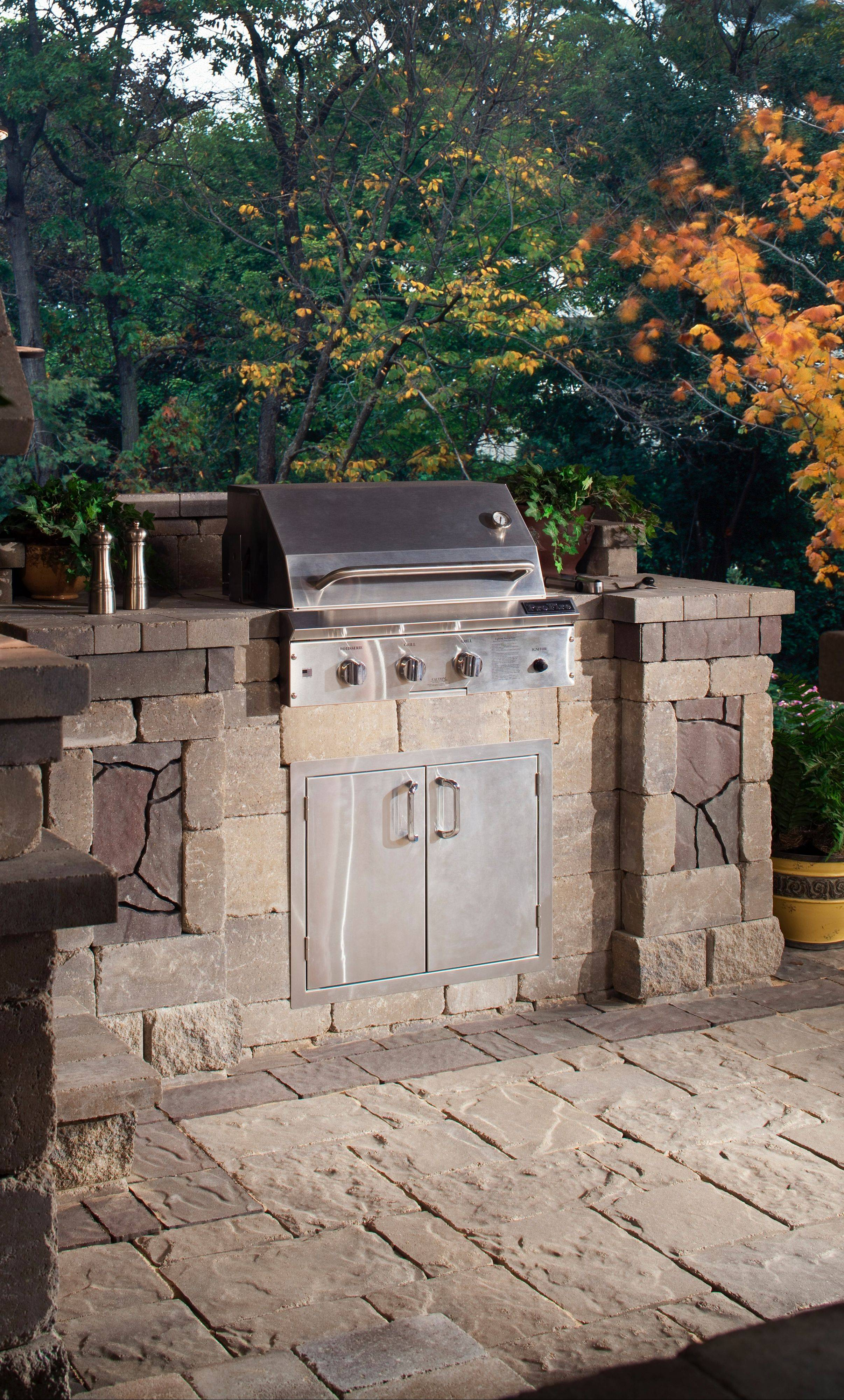 A grill island, like this Harmony Bristol model by Belgard, is a way for the cost-conscious to enter the outdoor-dining arena.