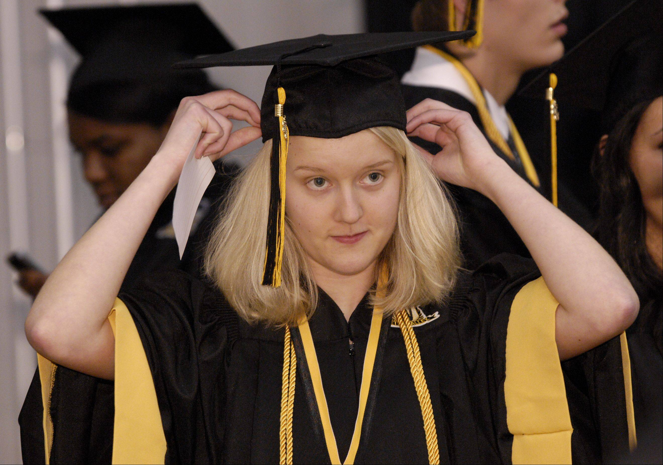 Kelly Koronkowski gets ready for the Metea Valley High School graduation on Sunday, May 26 at the NIU Convocation Center in DeKalb.