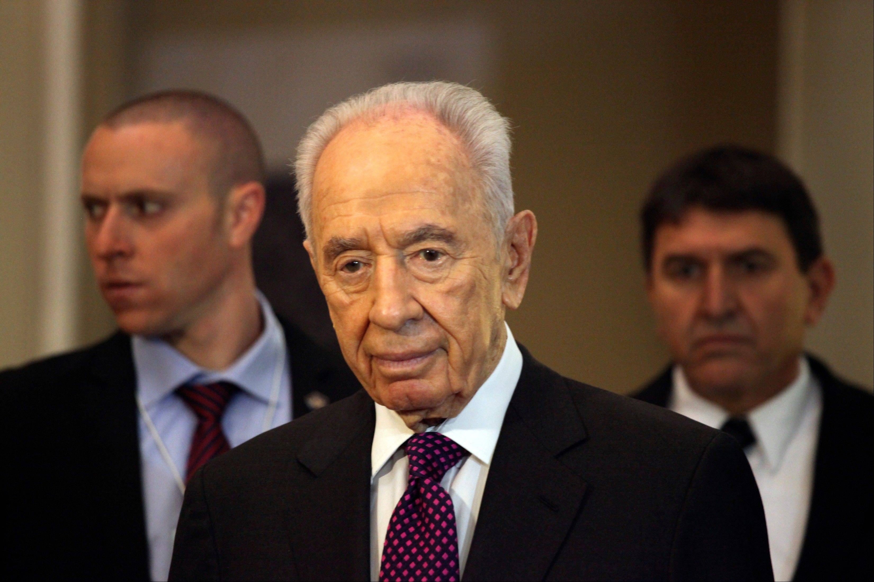 Associated Press Israeli President, Shimon Peres, arrives to give a brief statement at the World Economic Forum, in Southern Shuneh, 34 miles southeast of Amman, Jordan, Sunday, May 26, 2013. Peres says it is possible for Israelis and Palestinians to overcome differences and skepticism over peacemaking and that it is time to restart serious negotiations and conclude a peace treaty that has long dogged the two warring sides.