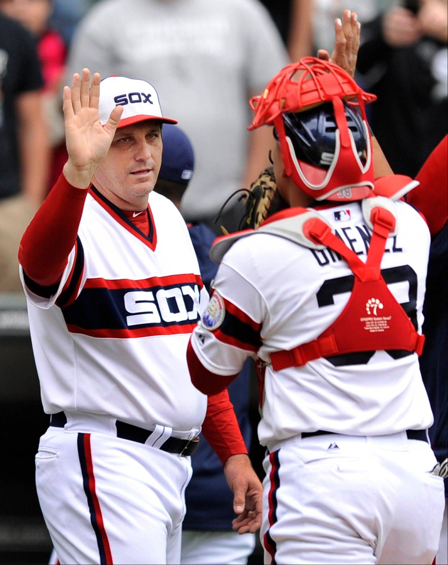 White Sox manager Robin Ventura celebrates with catcher Hector Gimenez after Sunday�s 5-3 victory over the Miami Marlins at U.S. Cellular Field.