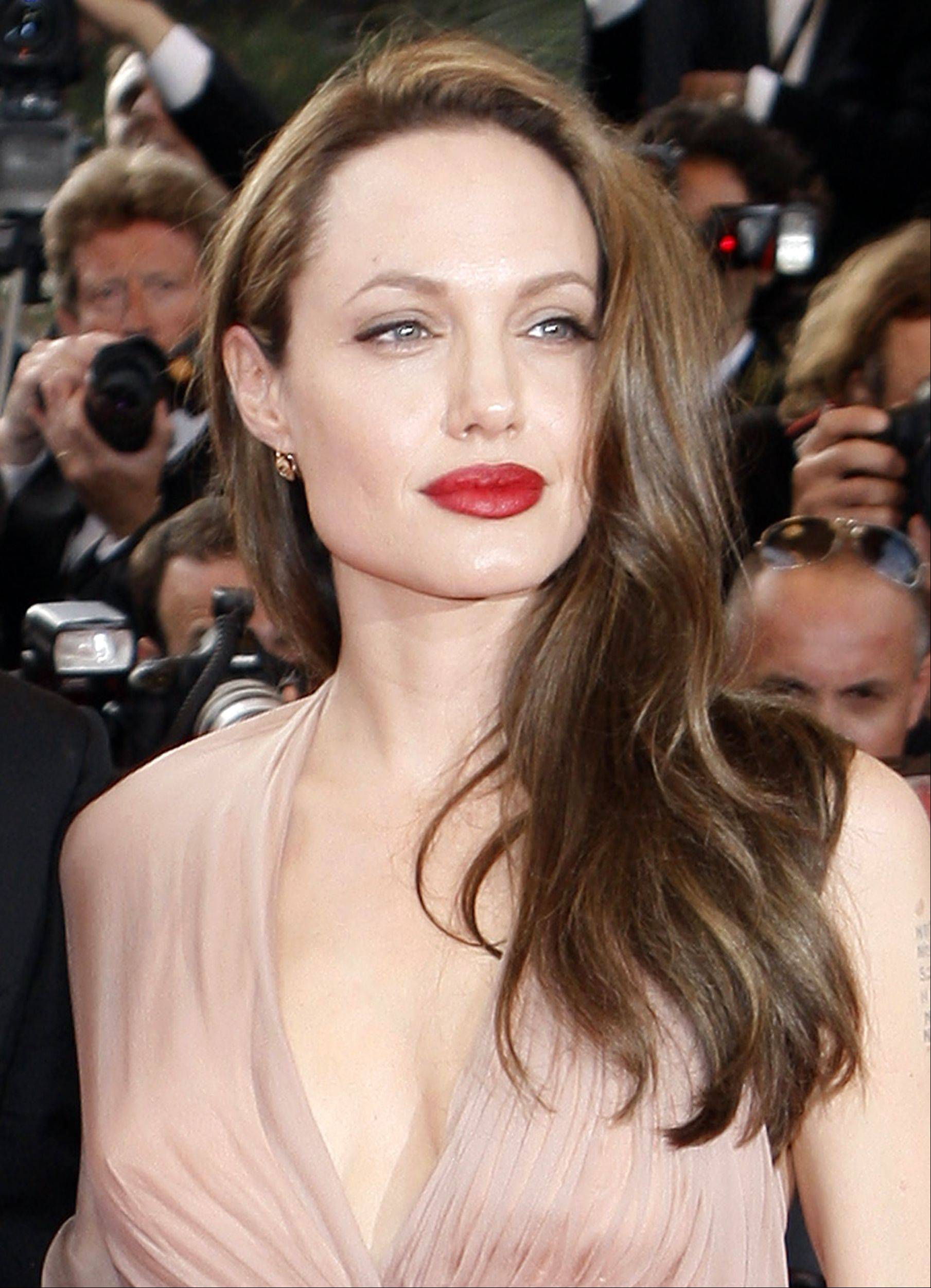 Angelina Jolie's aunt Debbie Martin died Sunday at age 61 of breast cancer. Jolie recently announced she had a double mastectomy to avoid breast cancer because her mother, Marchline Bertrand, Martin's sister died of the disease in 2007.