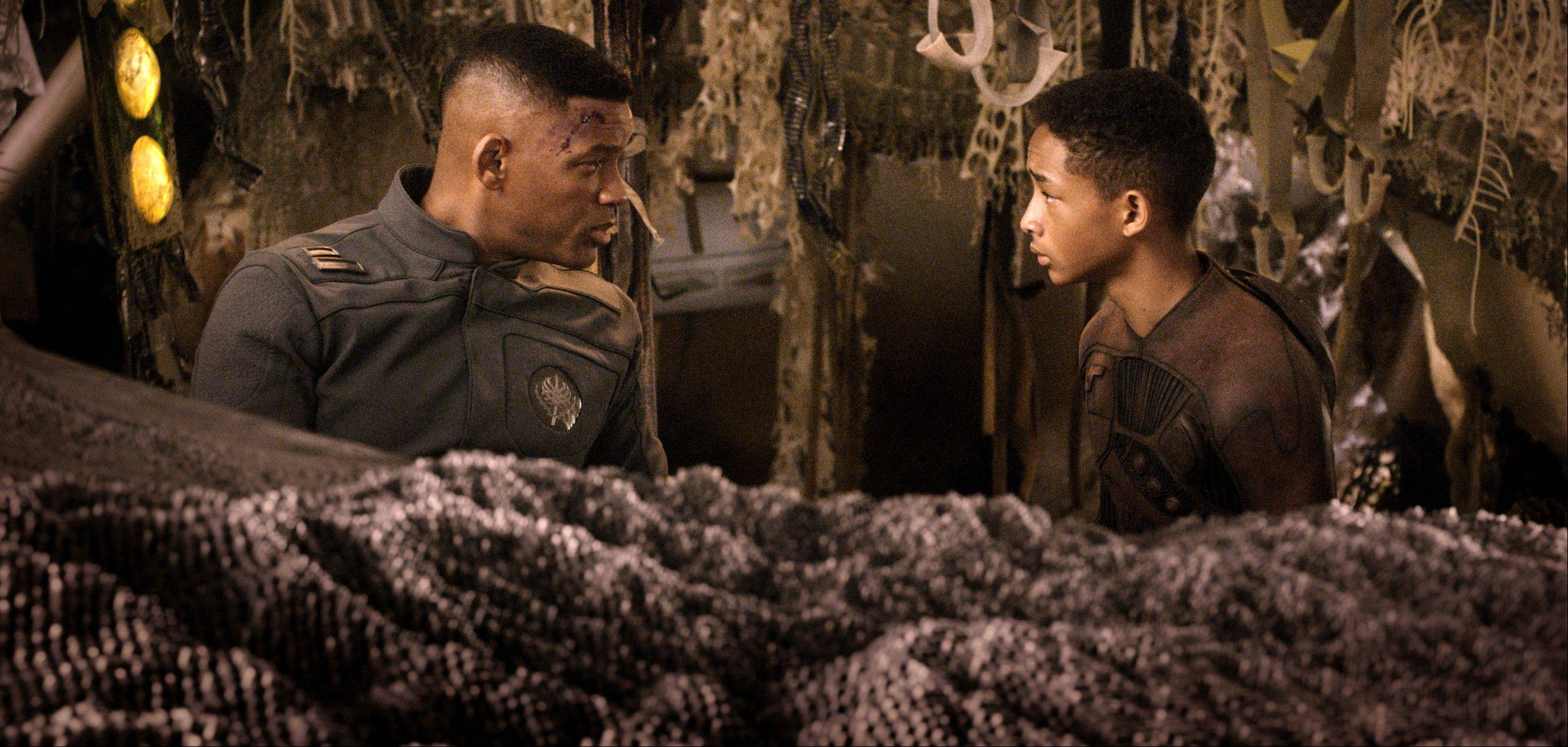 "This film publicity image released by Sony - Columbia Pictures shows Will Smith, left, and Jaden Smith in a scene from ""After Earth."""