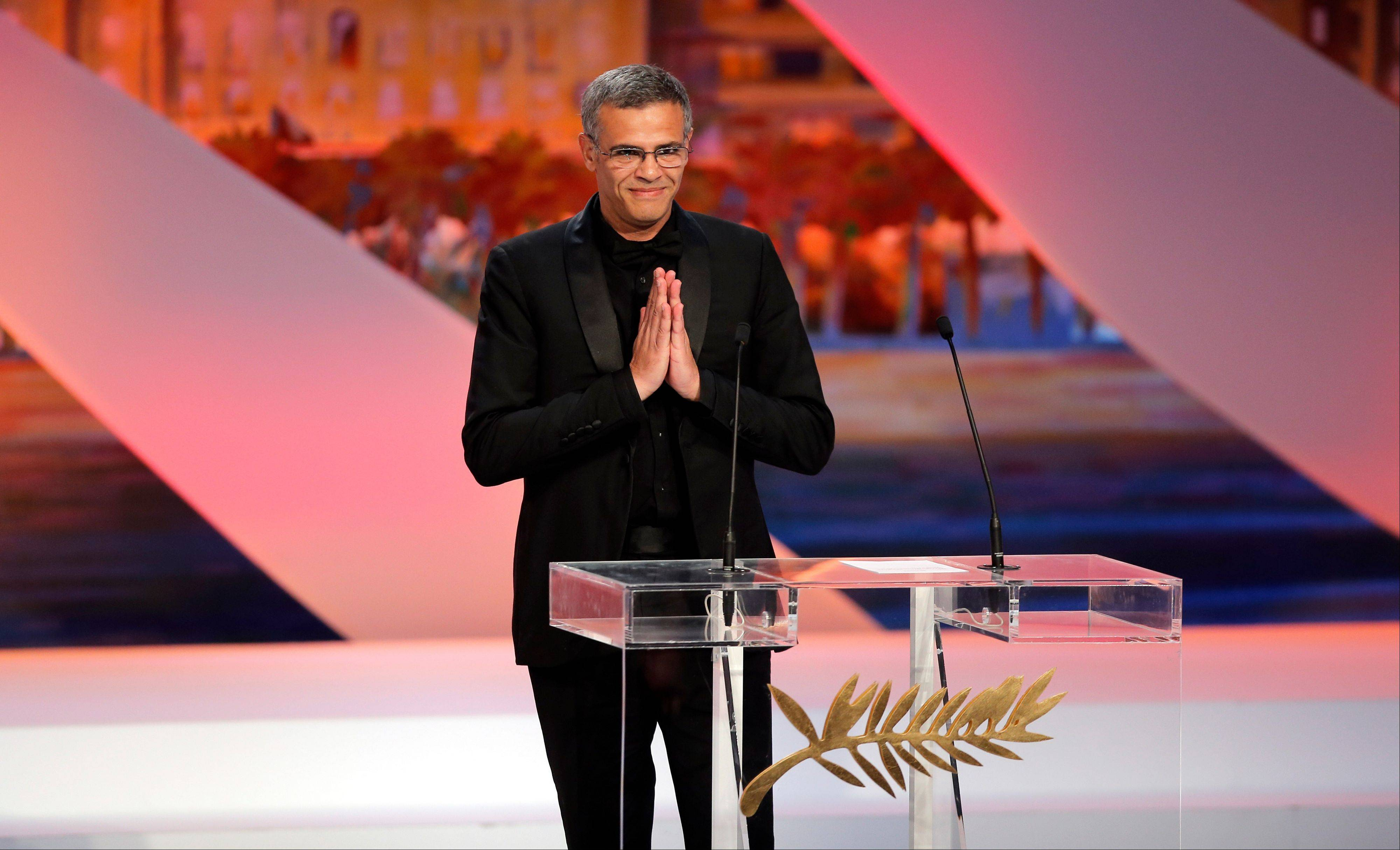 Director Abdellatif Kechiche gestures after being presented the Palme d'Or award for his film La Vie D'Adele during an awards ceremony at the 66th international film festival, in Cannes, southern France, Sunday, May 26, 2013.