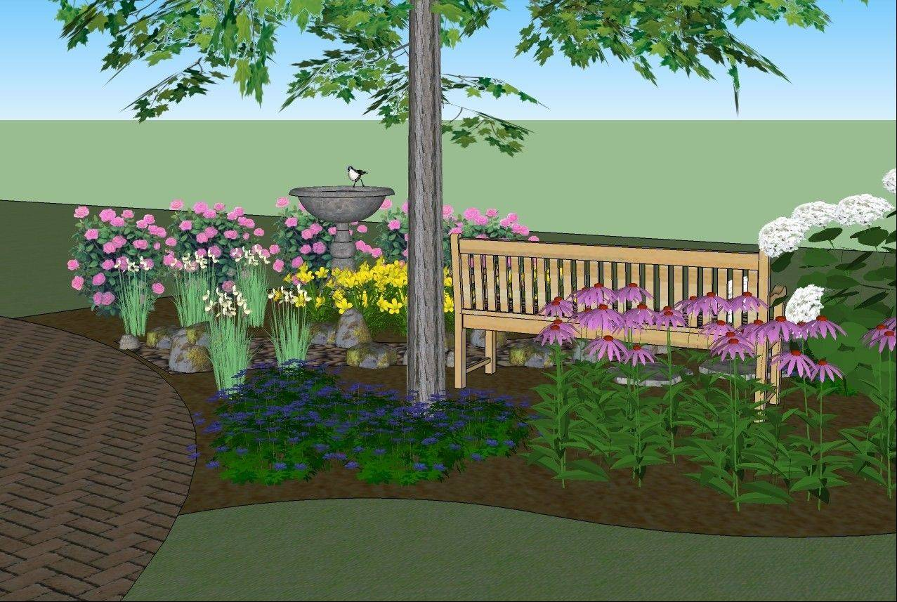 A bench and a bird bath make the new planting bed a relaxing place to spend time.