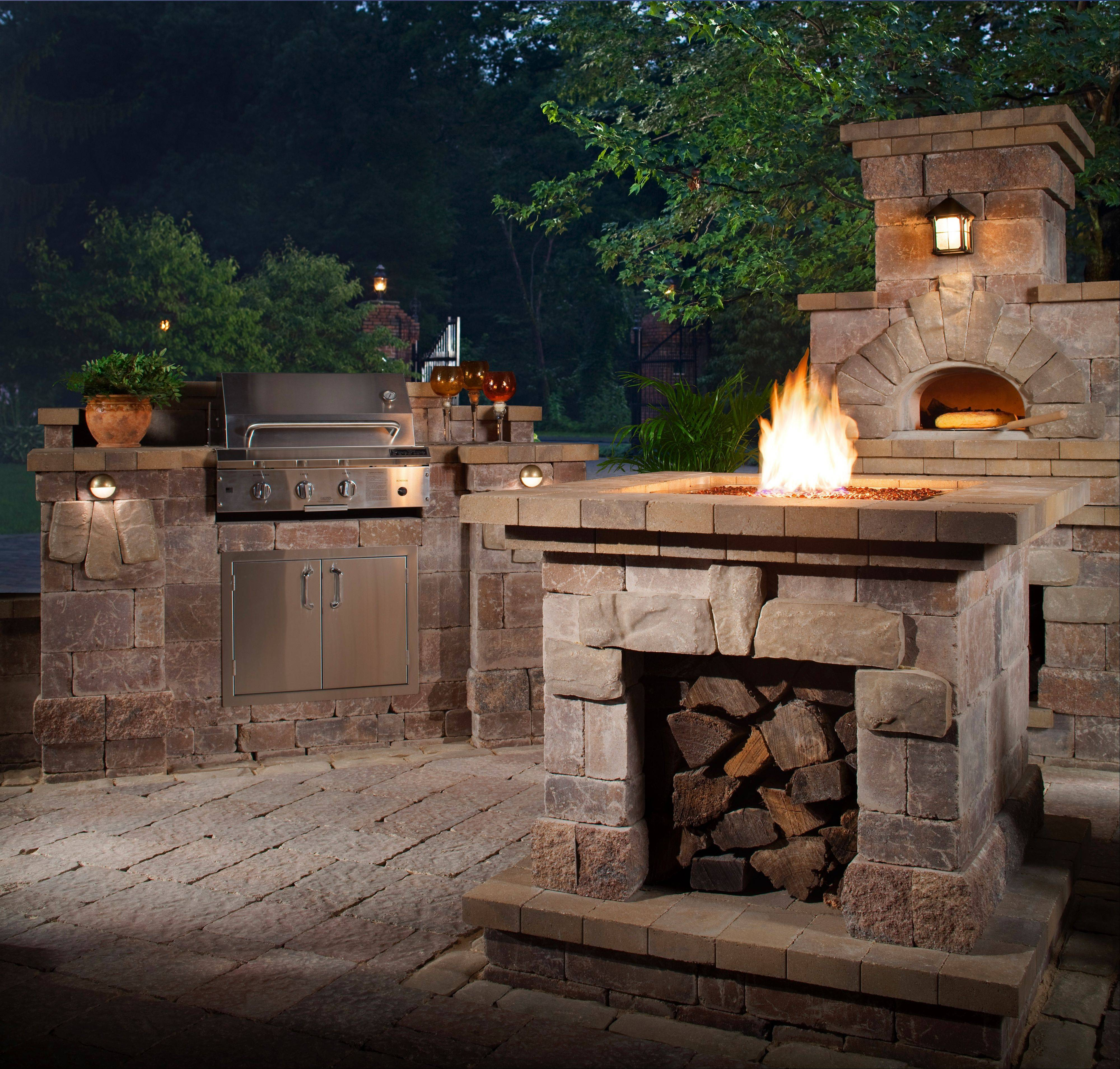 More and more homeowners are choosing a full outdoor experience, including a grill station, fire pit and brick oven, as show in the Harmoney Wexford collection by Belgard.
