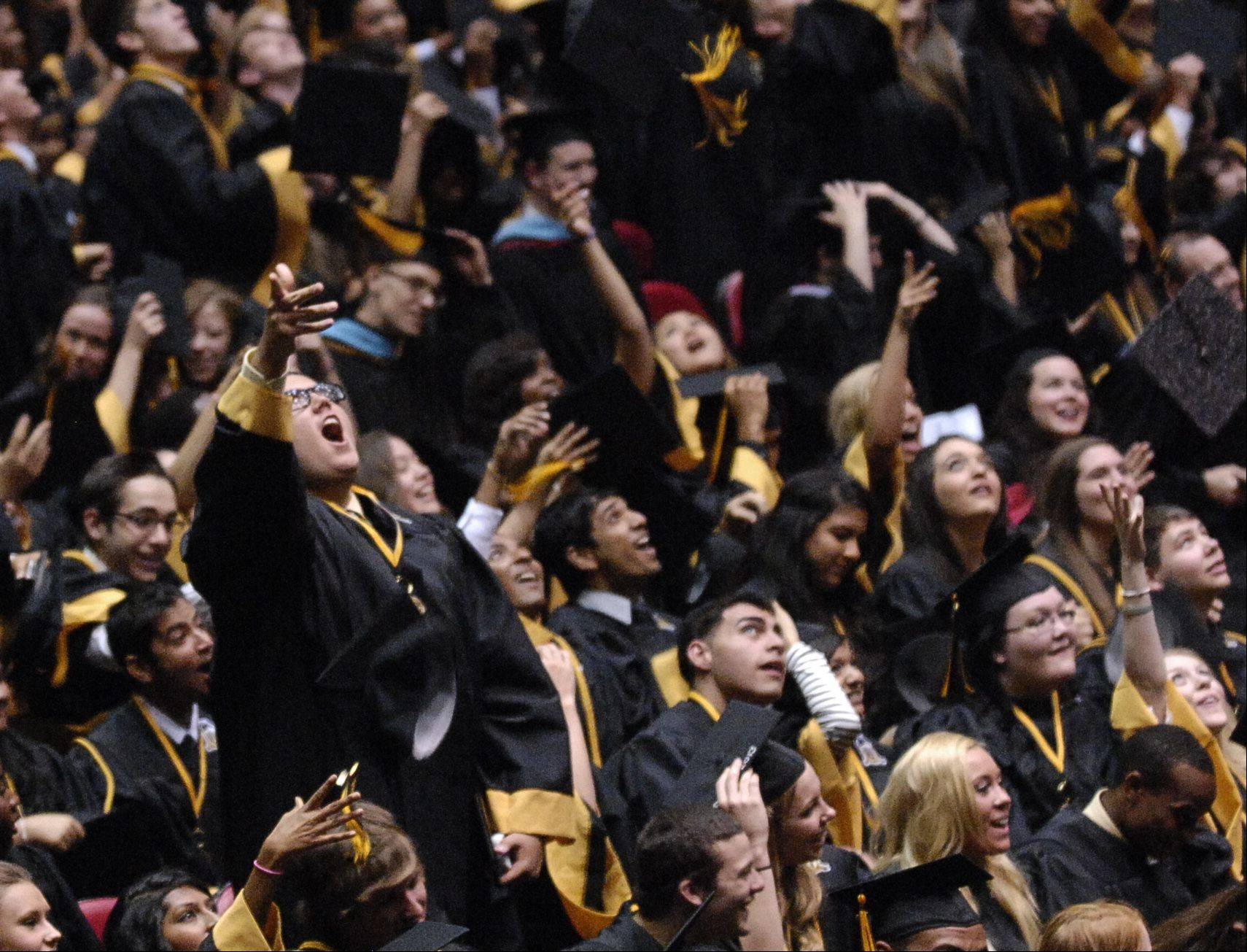 John O'Marrah tosses his cap in the air at the end of the Metea Valley High School graduation on Sunday, May 26 at the NIU Convocation Center in DeKalb.