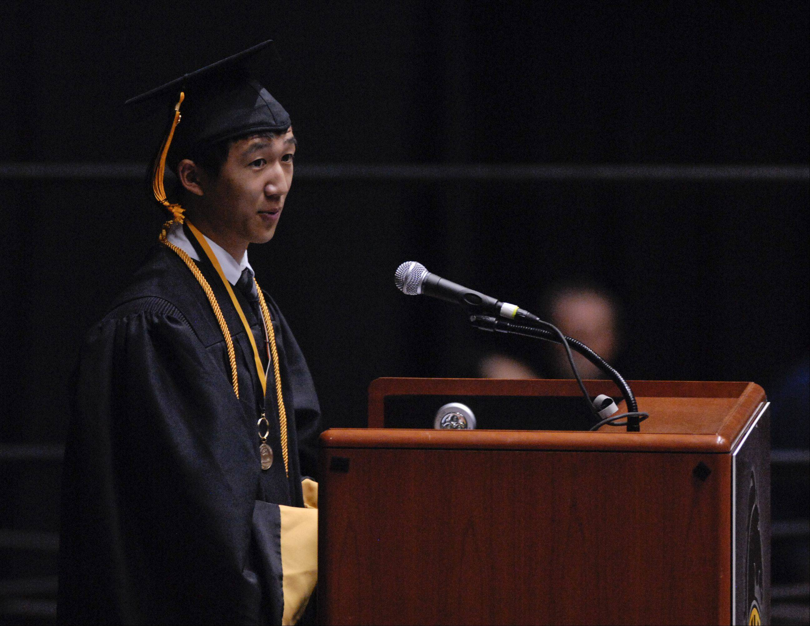 Eric Zhang gives the Senior Academic Farewell Address during the Metea Valley High School graduation on Sunday, May 26 at the NIU Convocation Center in DeKalb.