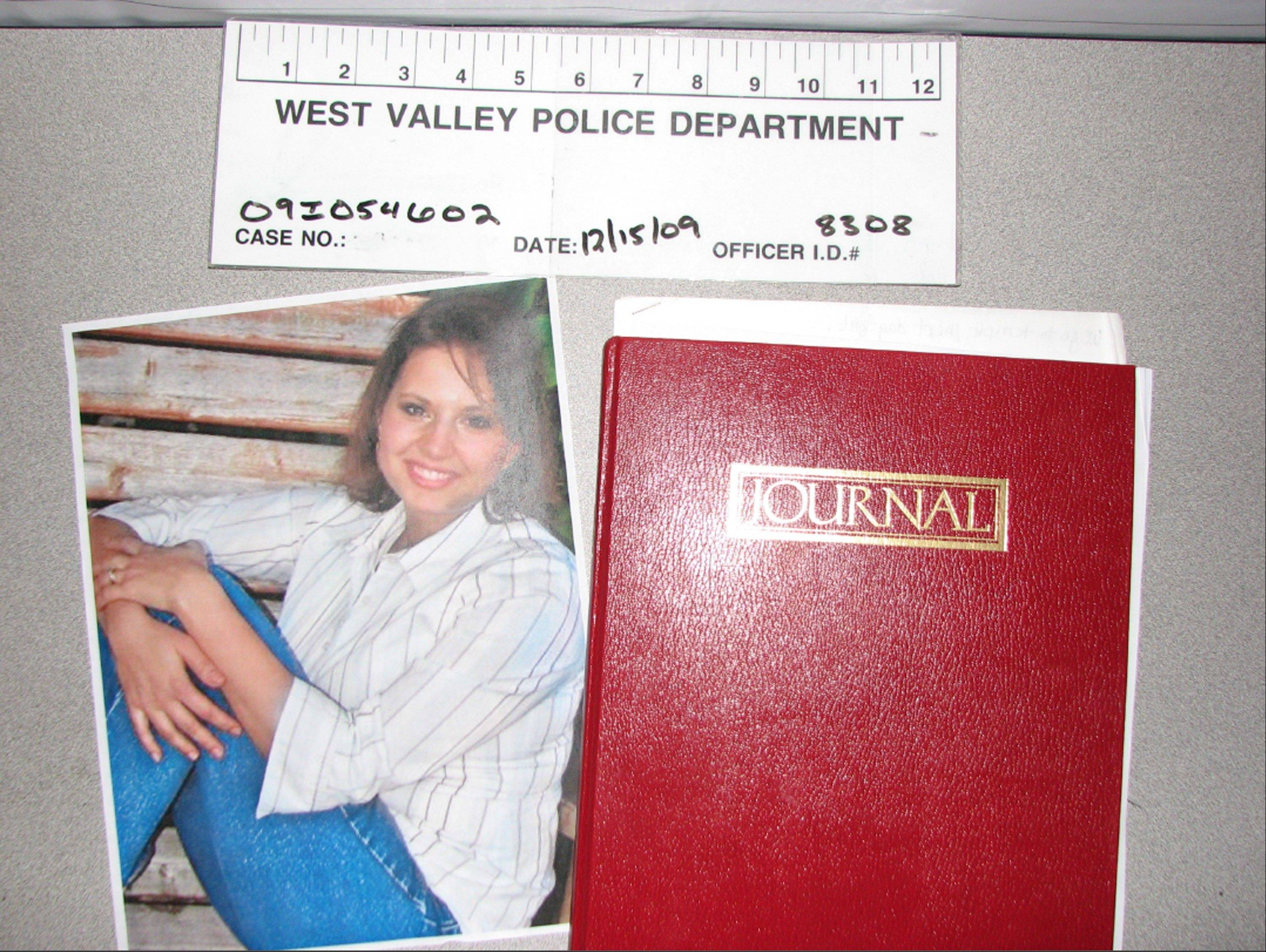 This evidence photo released Monday, May 20, 2013, by the West Valley City Police Department shows a journal collected from Josh and Susan Powell's house. Police released the case file, which includes details that have been kept under wraps since Powell vanished in 2009.