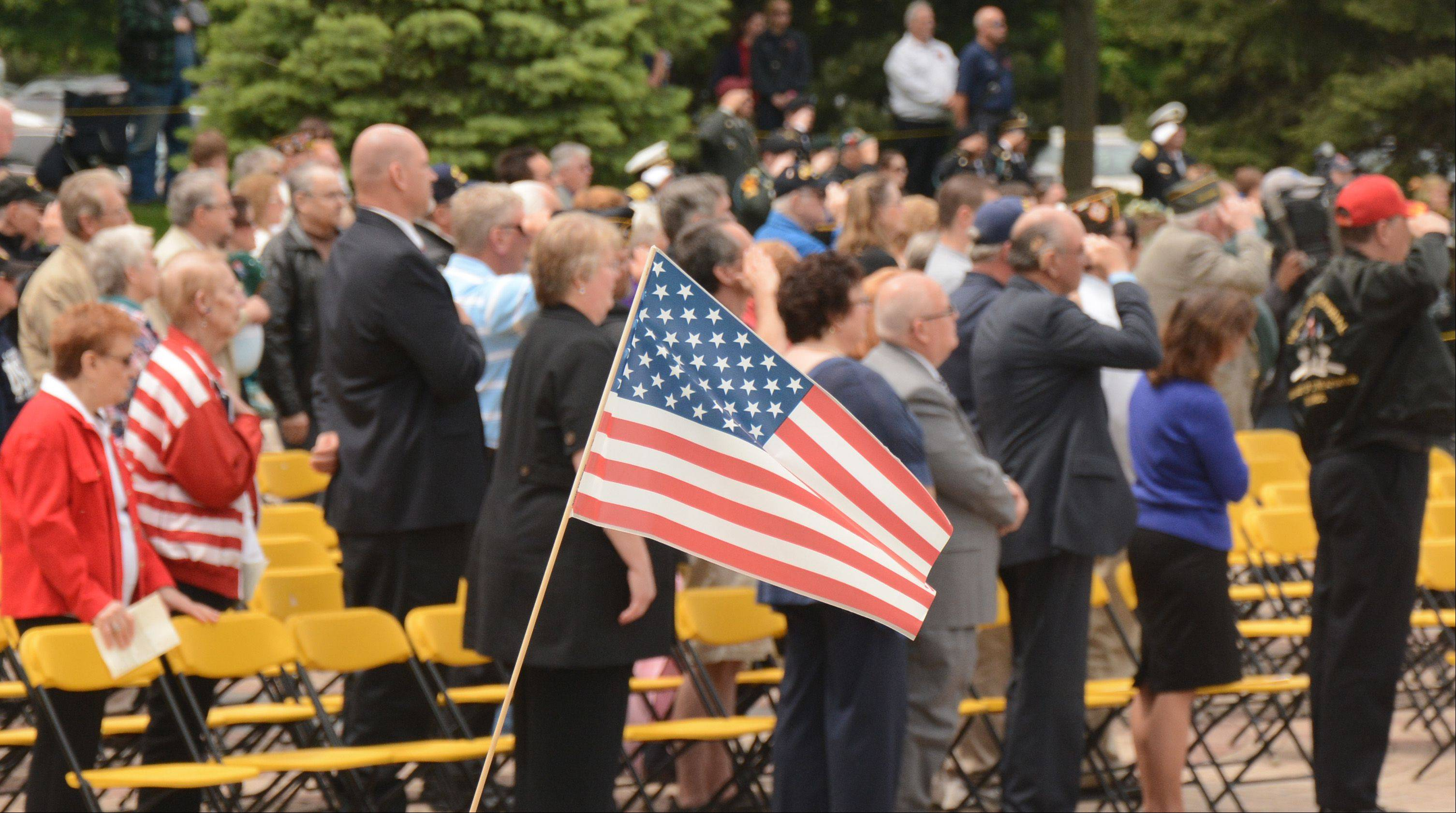 People say the Pledge of Allegiance to start the Streamwood Memorial Day Ceremony Sunday.