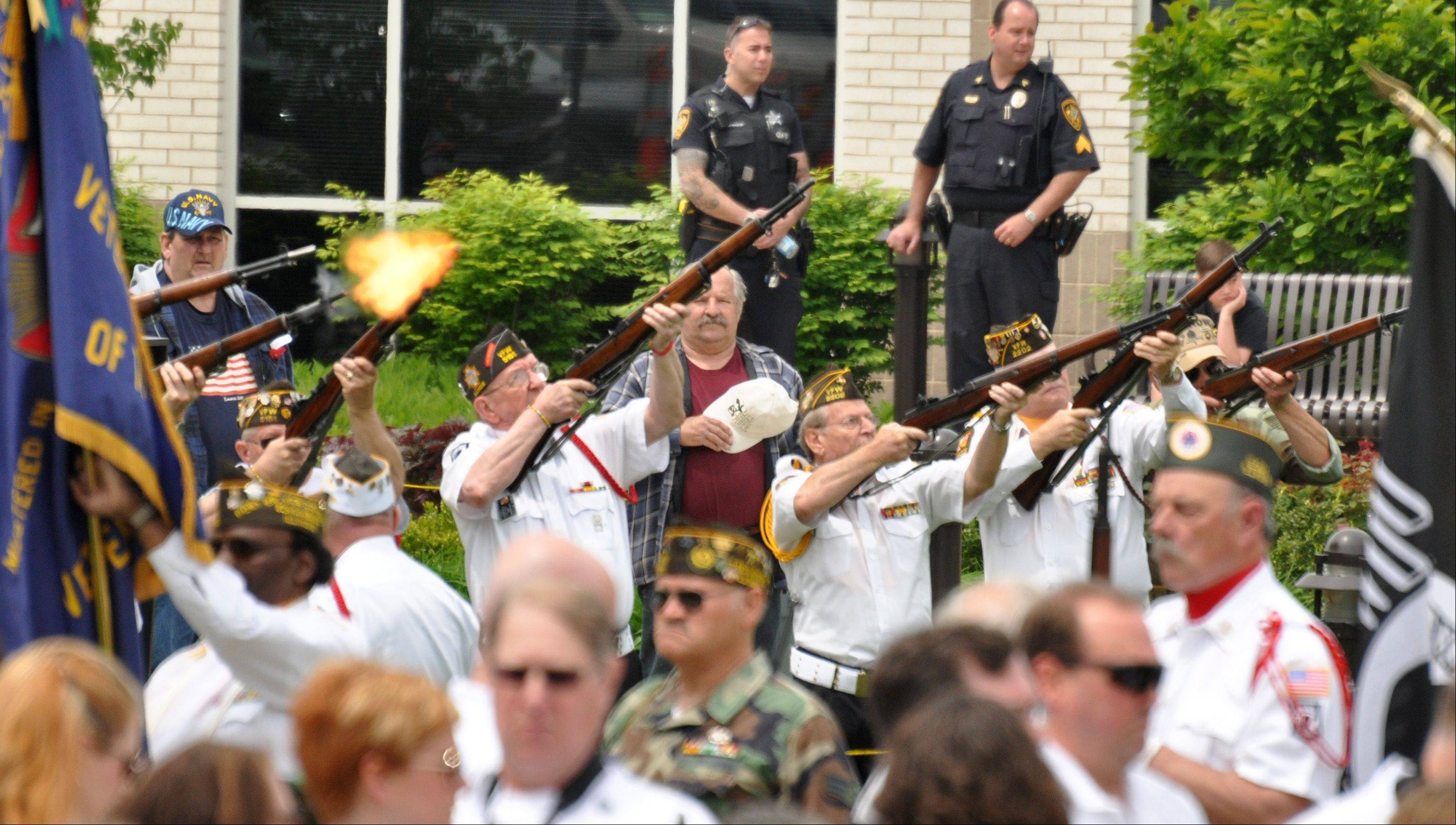 Members of Streamwood's VFW 5151 perform a 21-gun salute during Streamwood's Memorial Day ceremony Sunday.