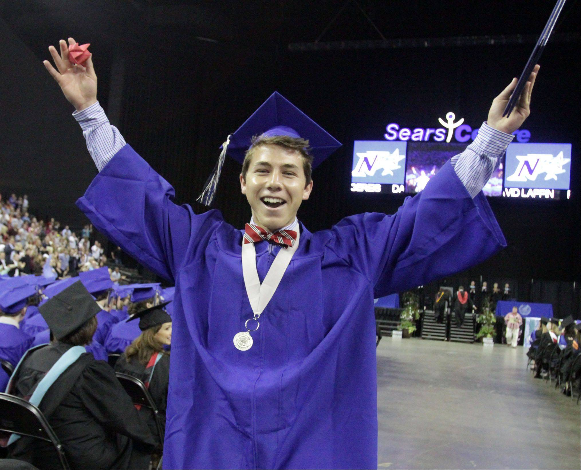 Connor Lefelstein celebrates being the last St Charles North High School senior to receive his diploma during the school's commencement ceremony at the Sears Centre in Hoffman Estates on Sunday, May 26, 2013.