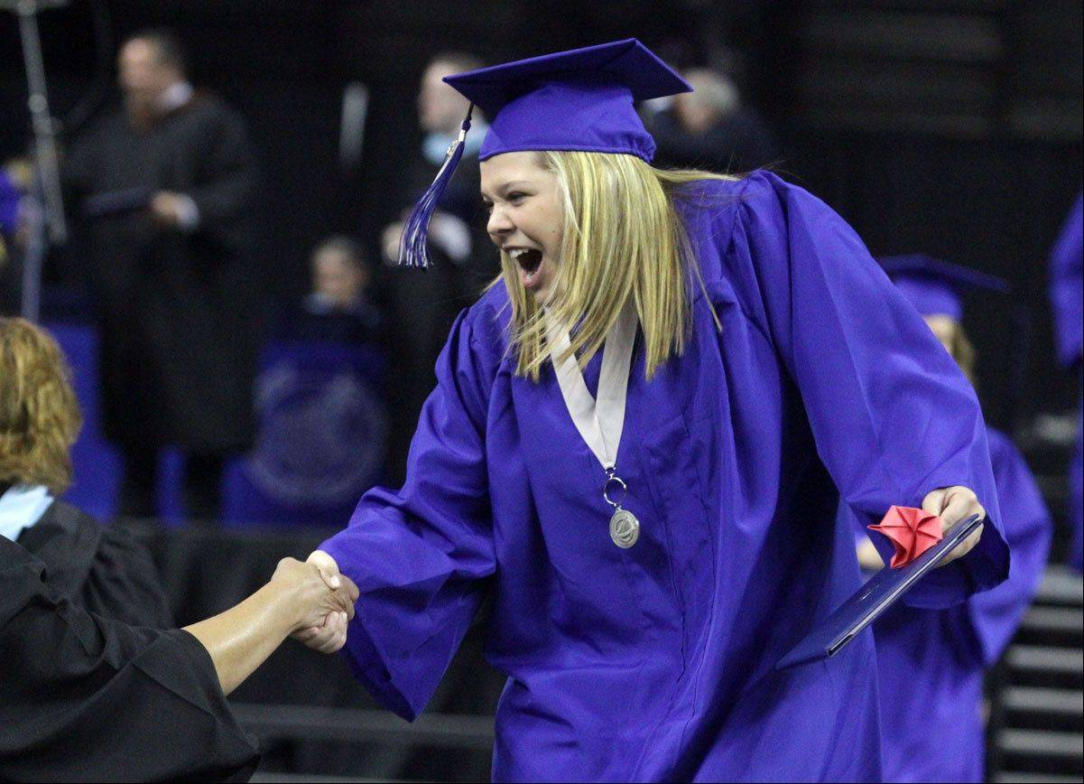 Carrie Douglas gets a hand after receiving her diploma at St Charles North High School commencement ceremony at the Sears Centre in Hoffman Estates on Sunday, May 26, 2013.