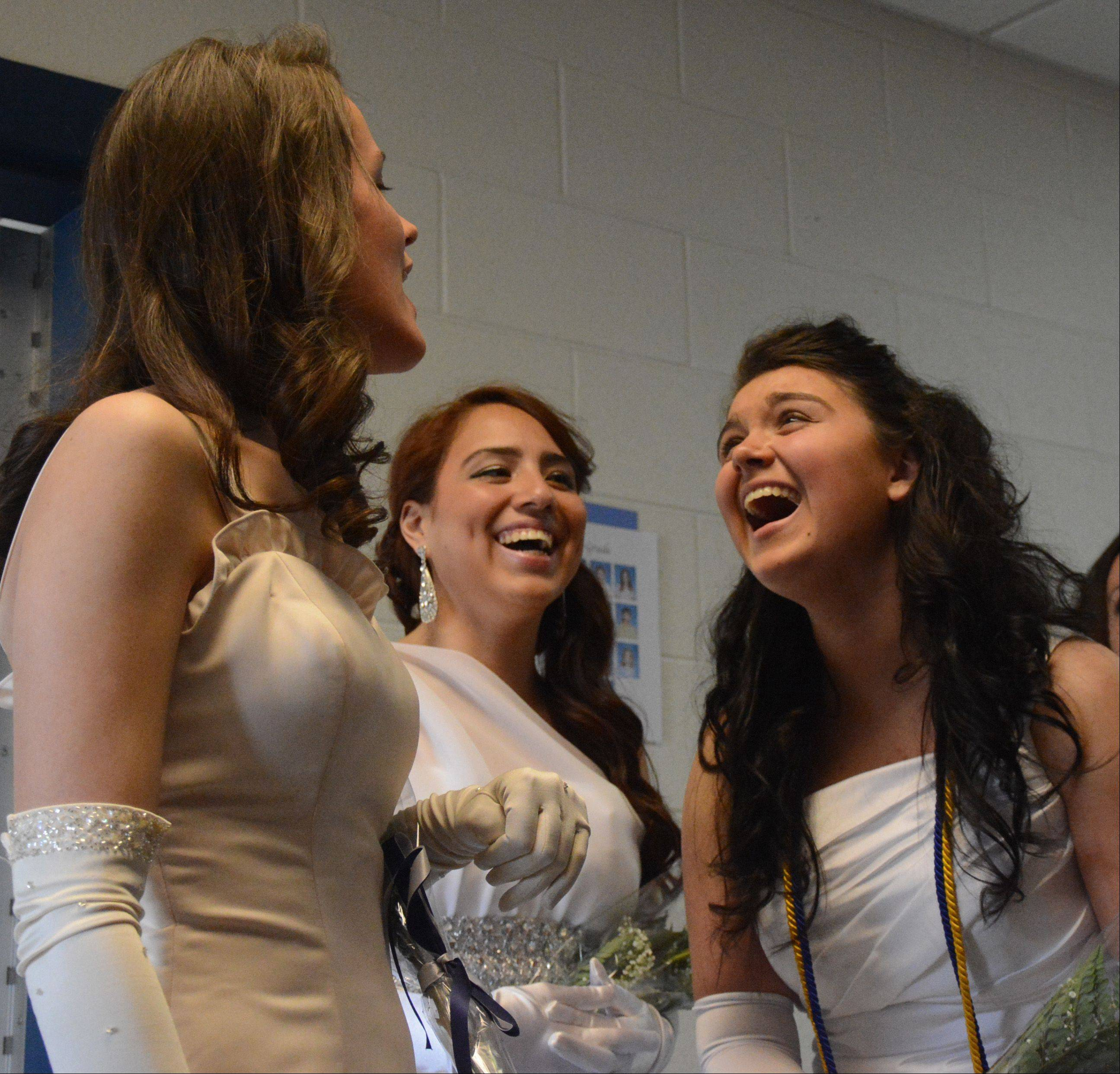 Dave Dvorak/ddvorak@dailyherald.comCarolina Avila, left, Breeze Alvarado and Crystal Avila laugh as they look at old pictures before the Willows Academy commencement Sunday.