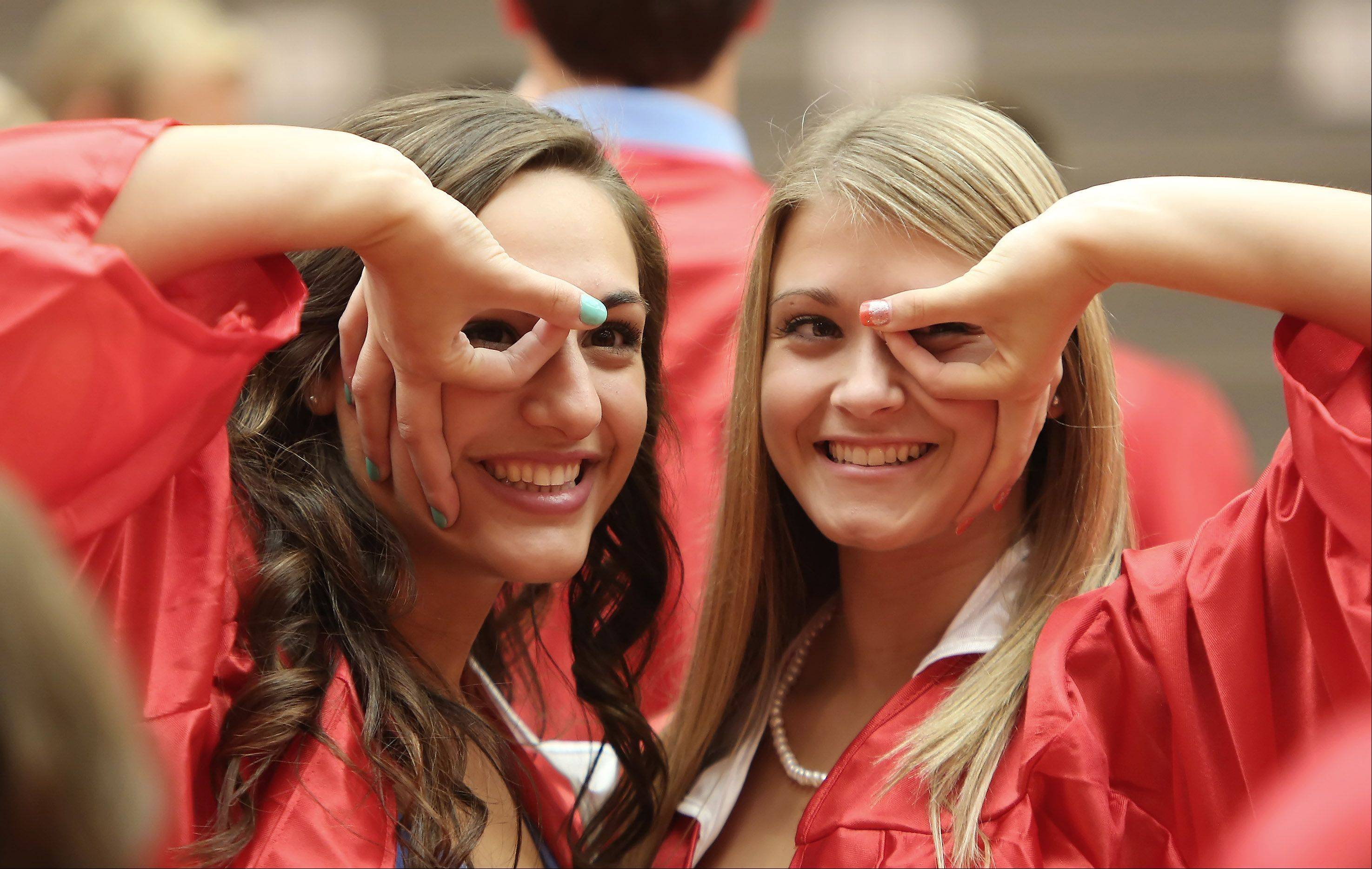 McKenzie Becker, left, and Hannah Fanella pose for a picture during the Grant High School graduation ceremony on Sunday. There were 399 seniors graduating this year at the school.