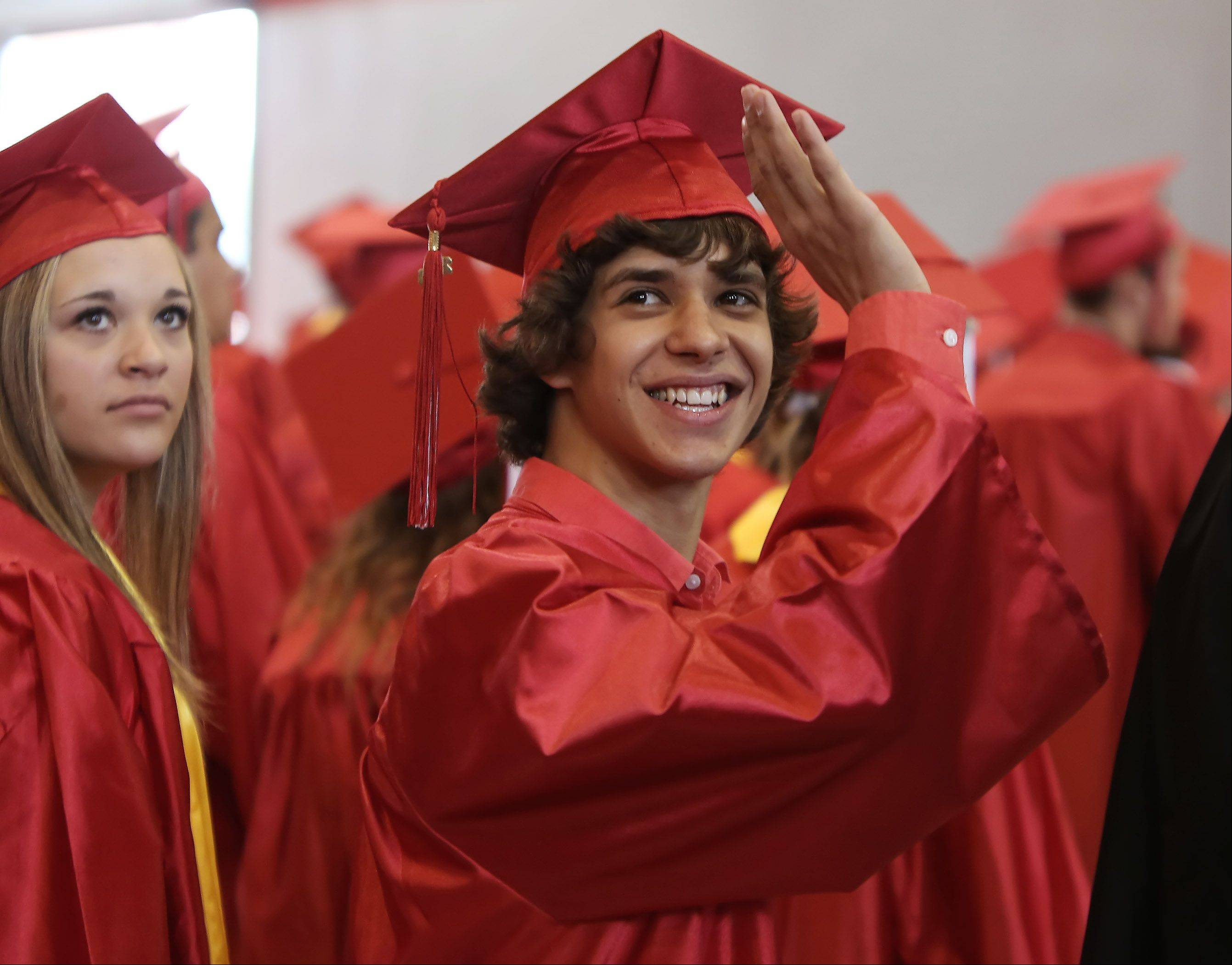 Nicholas Gier waves to family members during the Grant High School graduation ceremony on Sunday. There were 399 seniors graduating this year at the school.
