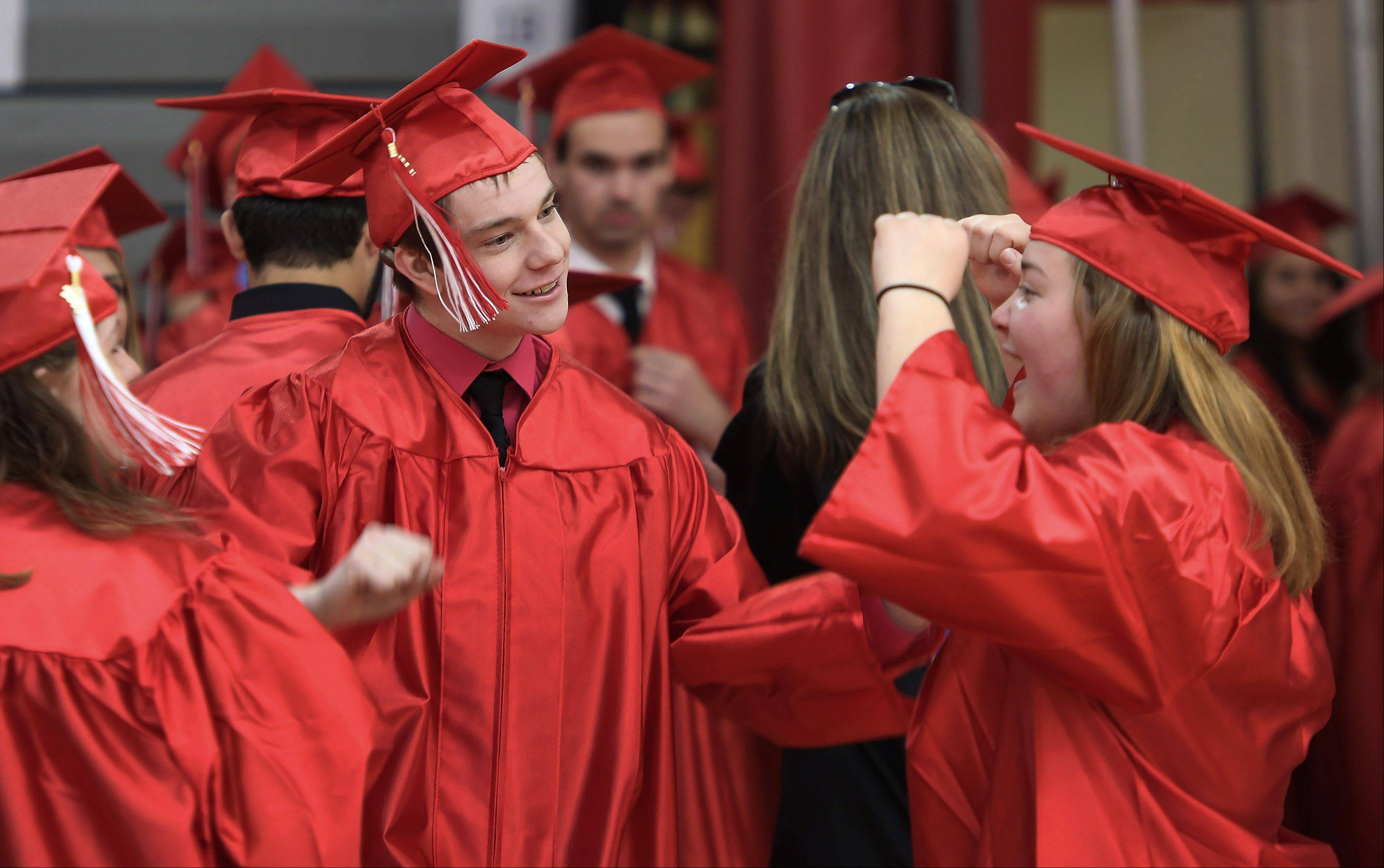 Kevin Farmer, left, dances with Felicia Ewig during the Grant High School graduation ceremony on Sunday. There were 399 seniors graduating this year at the school.