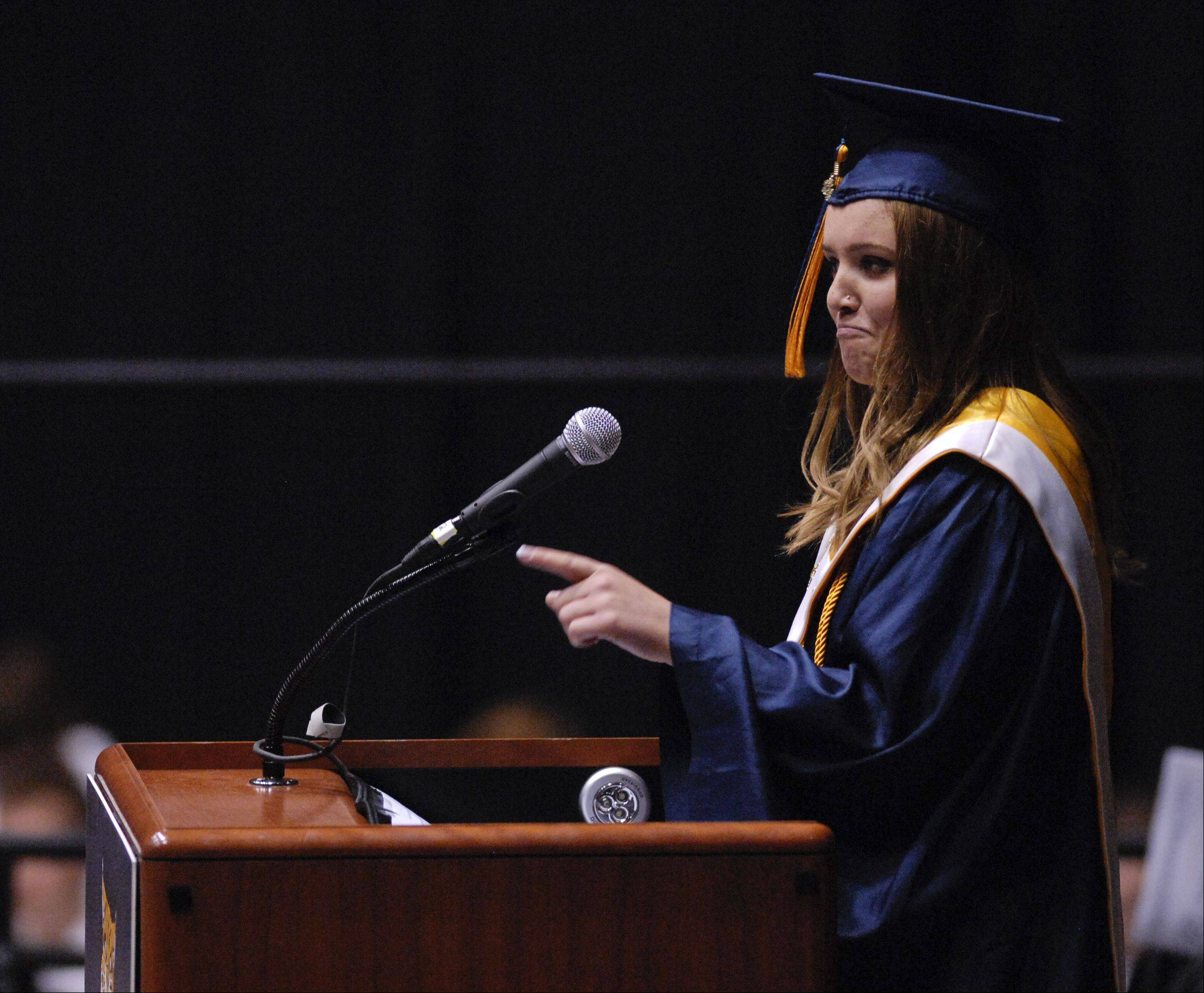 Abby Hanneman gives the Senior Reflections Address during the Neuqua Valley High School graduation on Sunday, May 26 at the NIU Convocation Center in DeKalb.