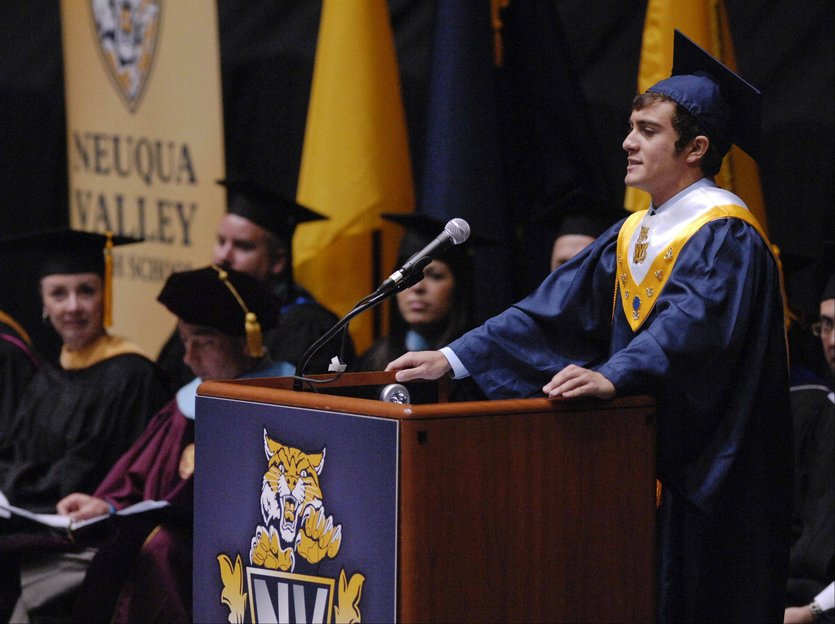 Gian Luis Delgado gives the Senior Academic Farewell during the Neuqua Valley High School graduation on Sunday, May 26 at the NIU Convocation Center in DeKalb.
