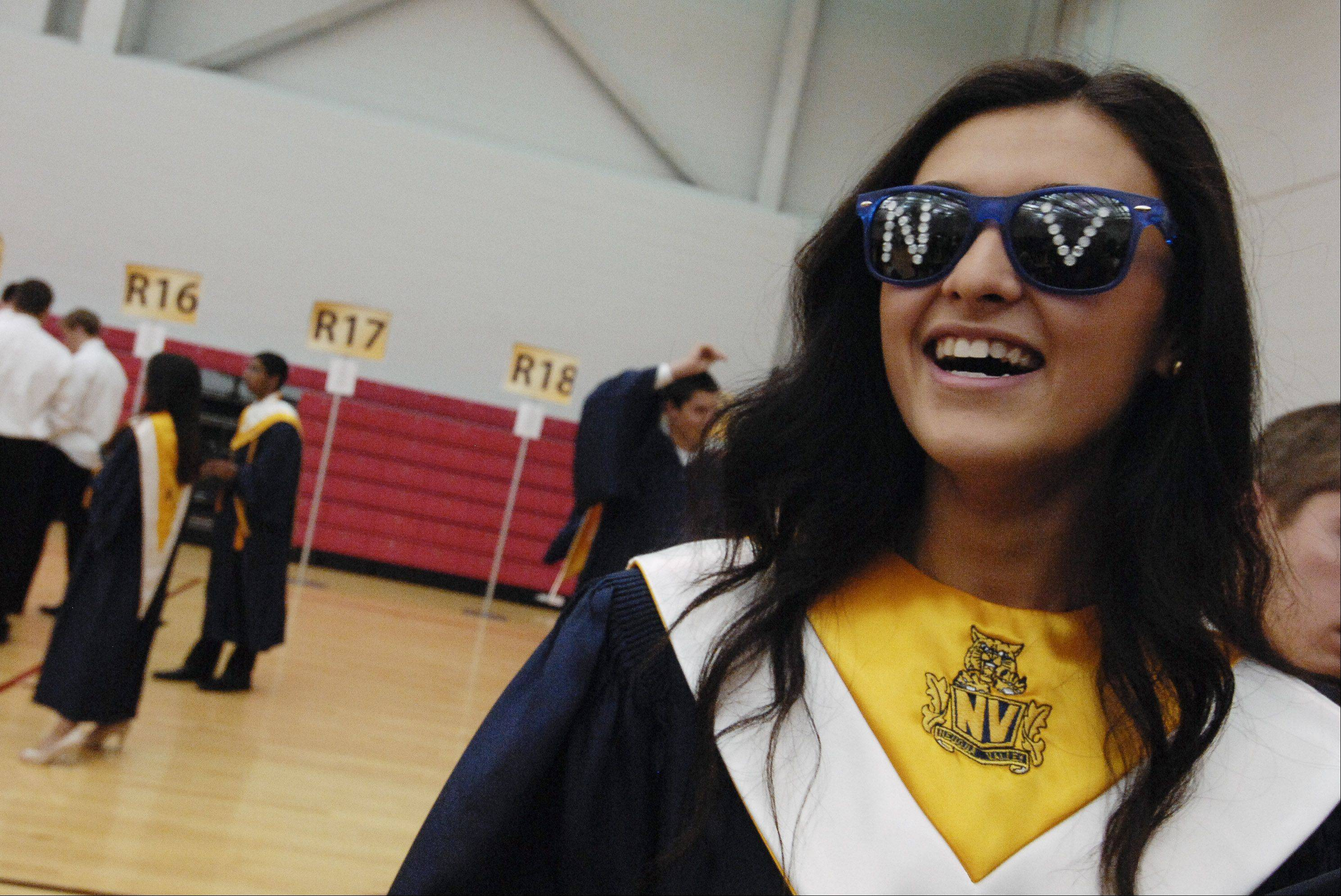 Ashley O'Hara-Marin sports sunglasses with the Neuqua Valley initials during after the Neuqua Valley High School graduation on Sunday, May 26 at the NIU Convocation Center in DeKalb.